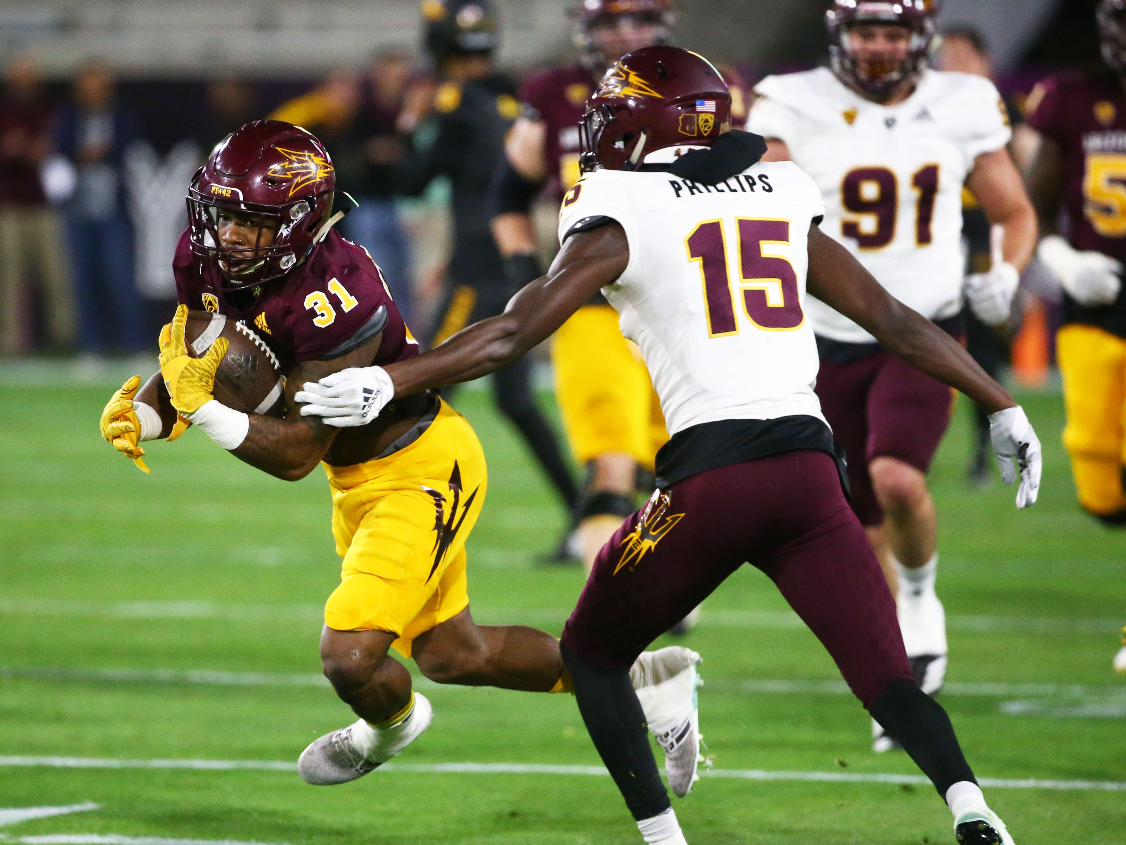 Arizona State running back Isaiah Floyd (31) runs with the ball during the spring practice game on Feb. 28, 2019 at Sun Devil Stadium in Tempe, Ariz.