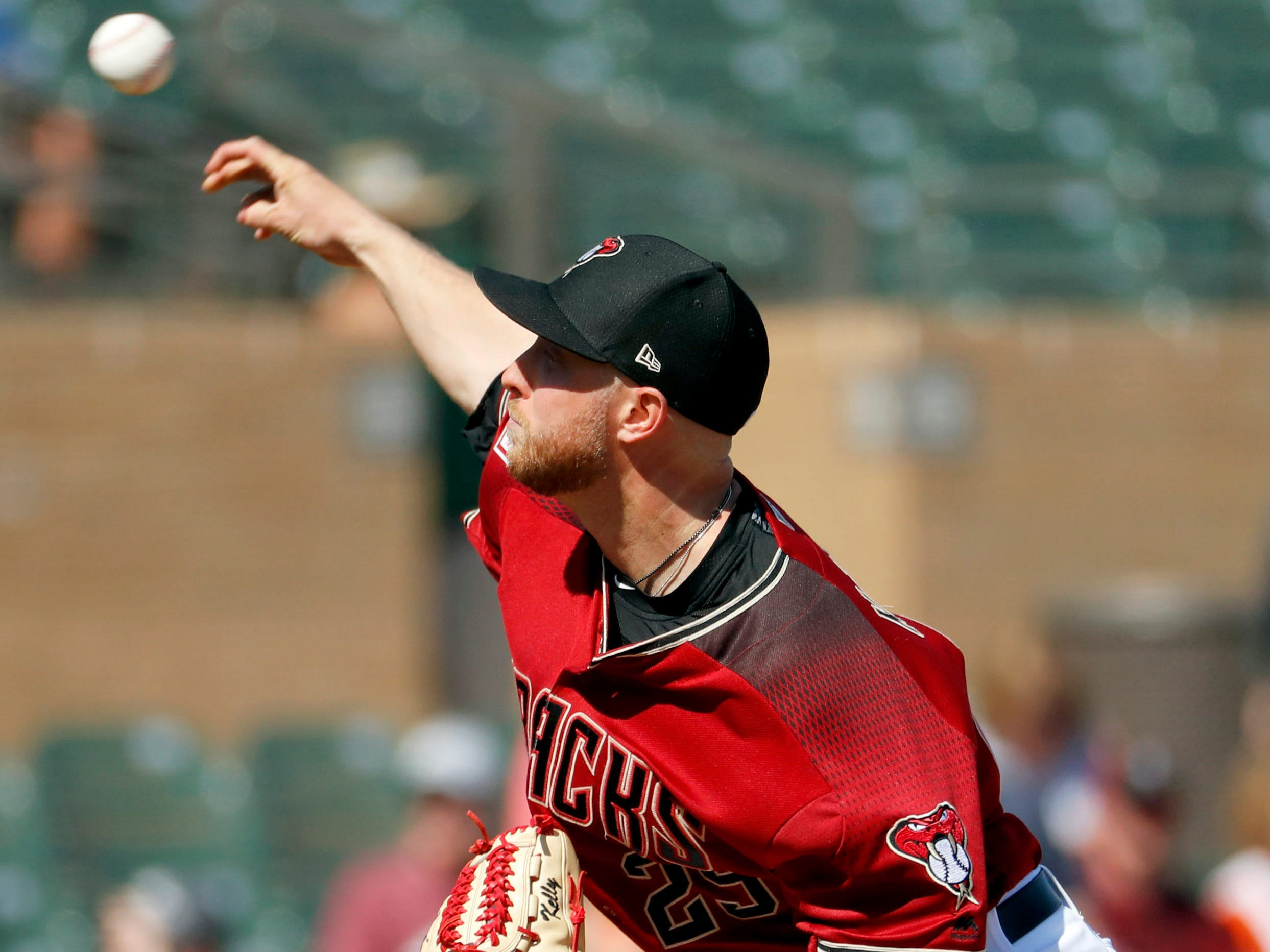 Arizona Diamondbacks pitcher Merrill Kelly throws against the Cleveland Indians during the first inning of a spring training baseball game, Thursday, Feb. 28, 2019, in Scottsdale, Ariz.