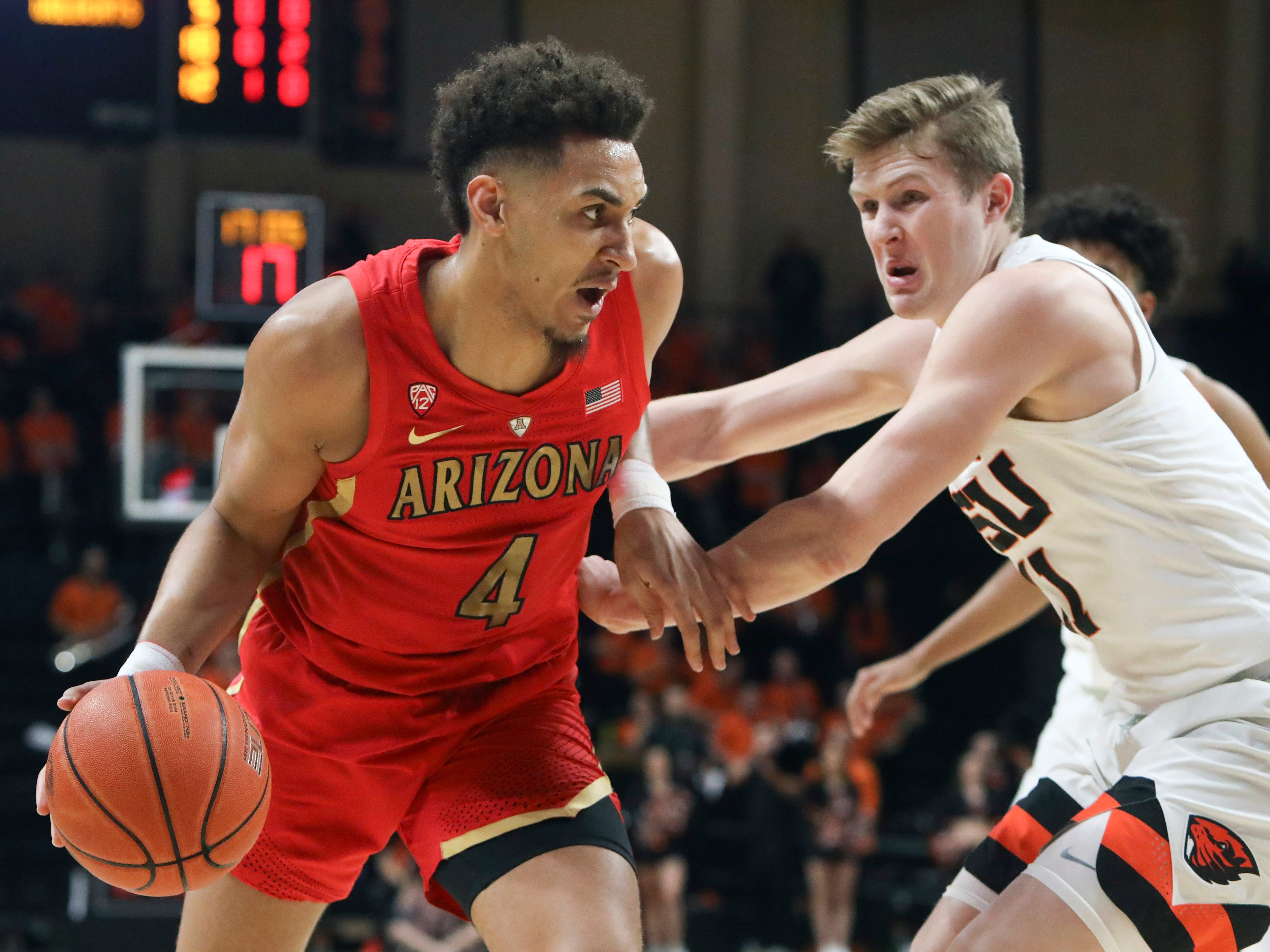 Arizona's Chase Jeter (4) drives around Oregon State's Zach Reichle (11) during the first half of an NCAA college basketball game in Corvallis, Ore., Thursday, Feb. 28, 2019.