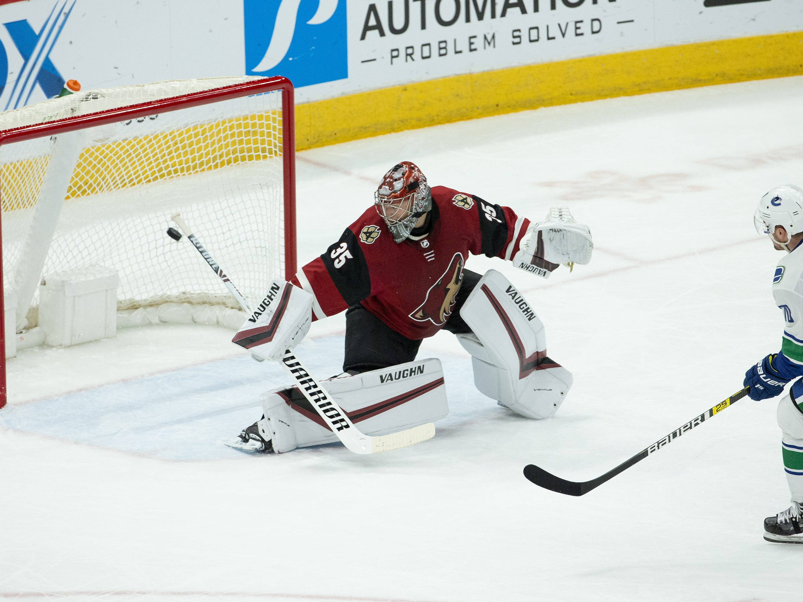 Arizona Coyotes goaltender Darcy Kuemper (35) can't stop the goal by Vancouver Canucks left wing Tanner Pearson (70) during a NHL game at Gila River Arena in Glendale on February 28.