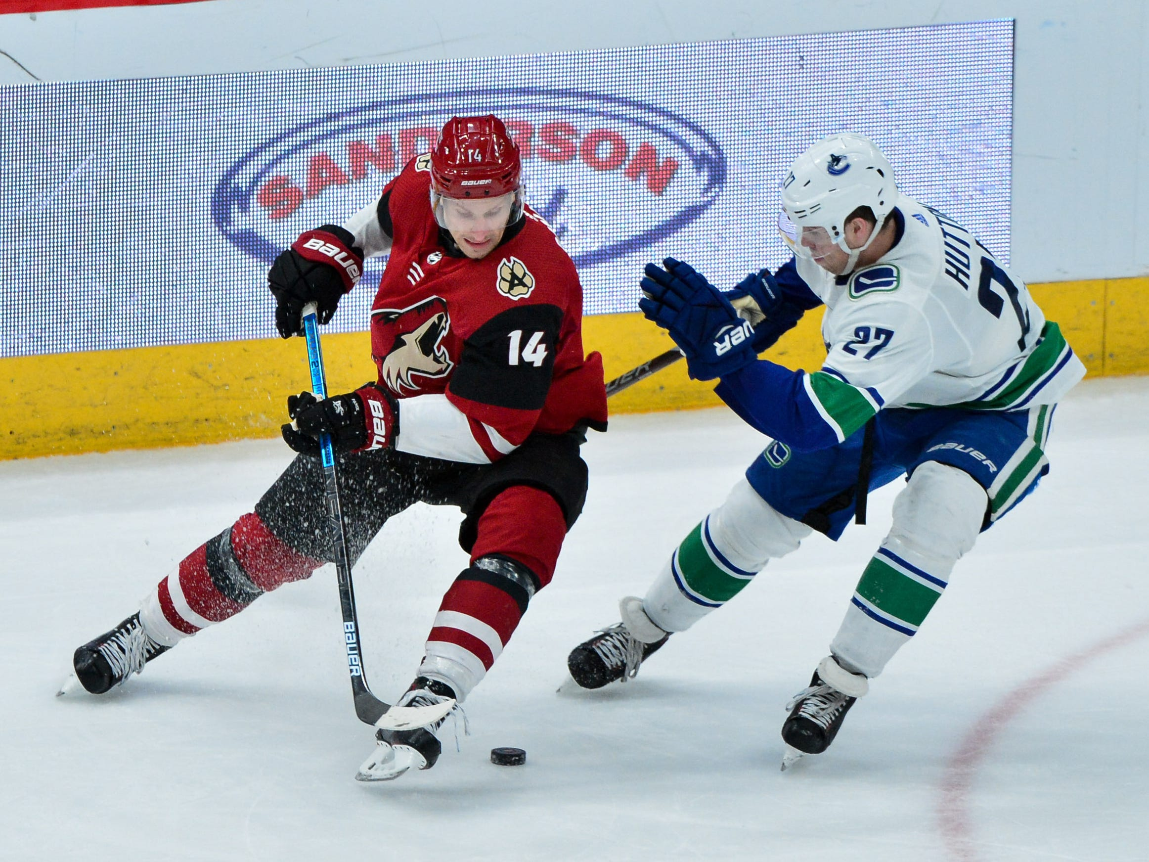 Feb 28, 2019; Glendale, AZ, USA; Arizona Coyotes right wing Richard Panik (14) skates with the puck against the Vancouver Canucks during the third period at Gila River Arena.