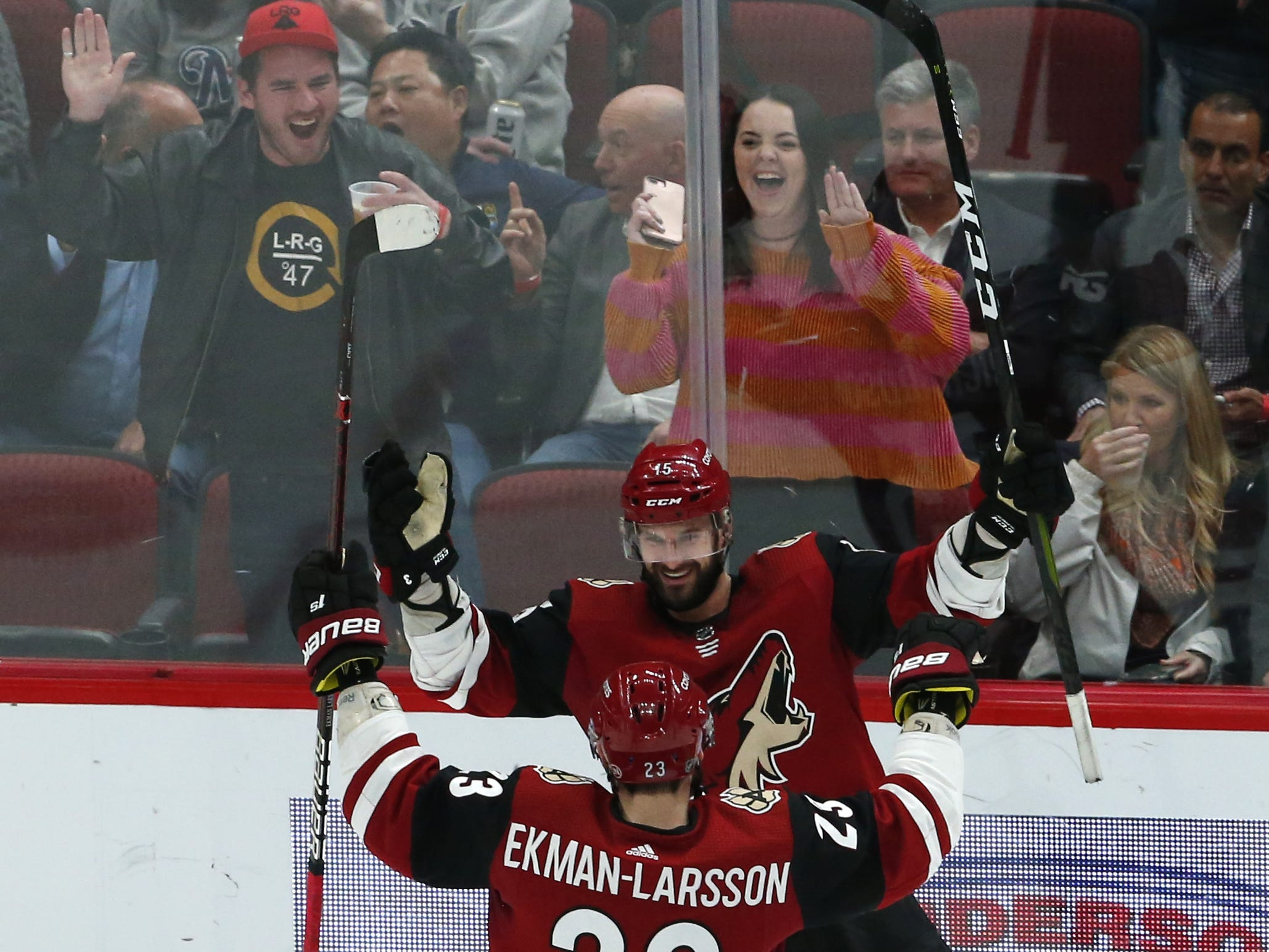 Arizona Coyotes center Brad Richardson (15) celebrates his hat trick with teammate defenseman Oliver Ekman-Larsson (23) during a NHL game against the Vancouver Canucks at Gila River Arena in Glendale on February 28.