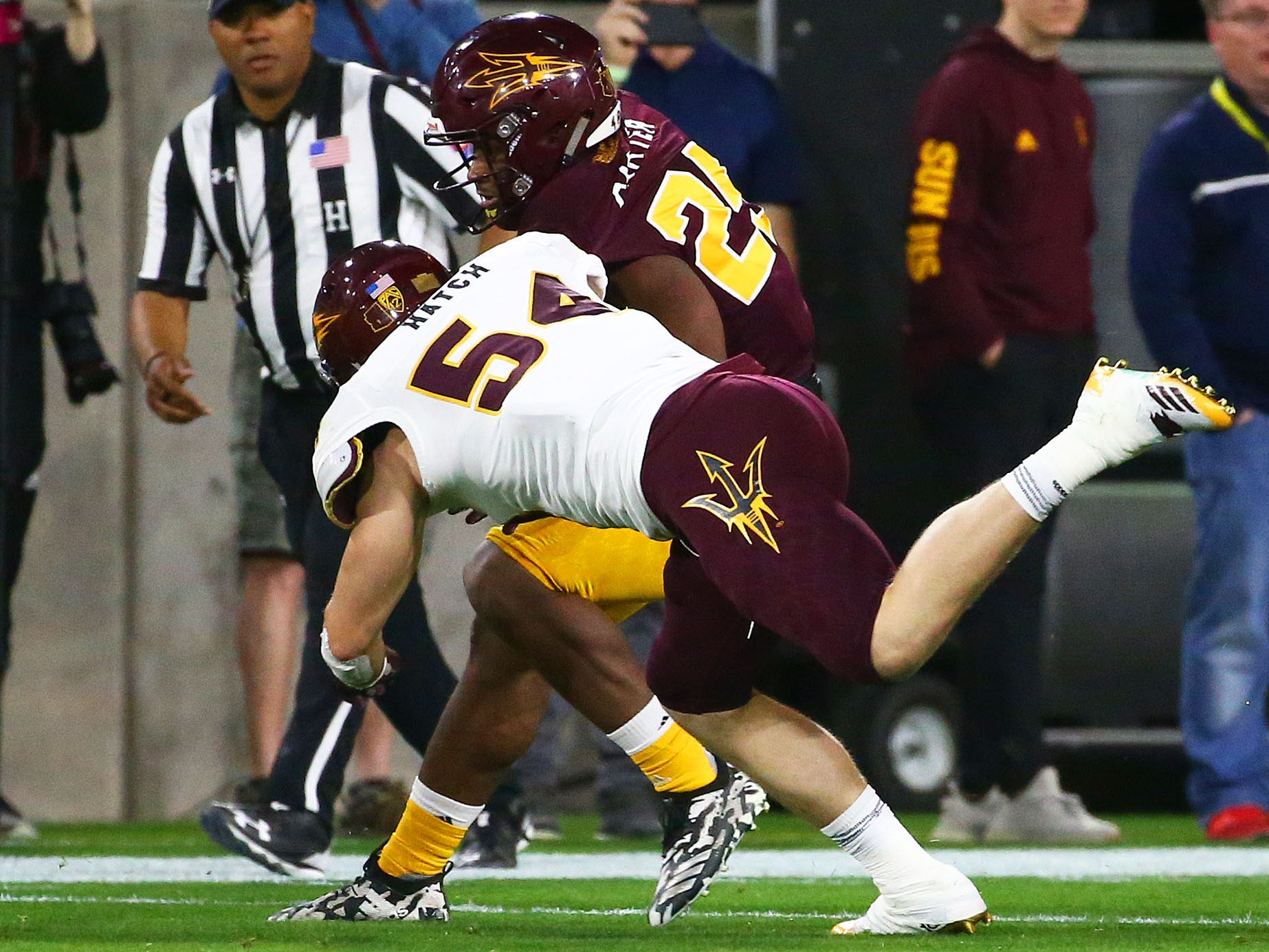 Arizona State linebacker Case Hatch (54) makes a tackle during the spring practice game on Feb. 28, 2019 at Sun Devil Stadium in Tempe, Ariz.