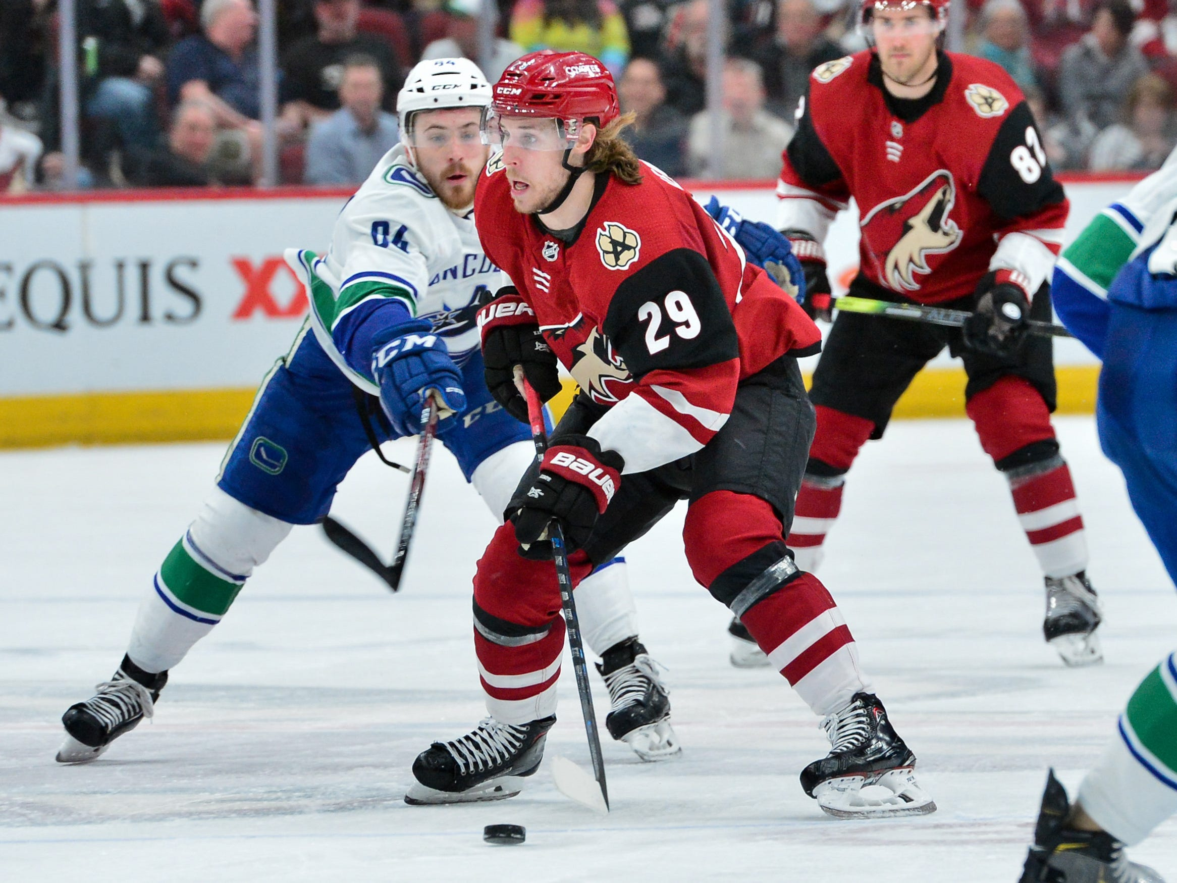 Feb 28, 2019; Glendale, AZ, USA; Arizona Coyotes right wing Mario Kempe (29) skates with the puck as Vancouver Canucks center Tyler Motte (64) defends during the second period at Gila River Arena.