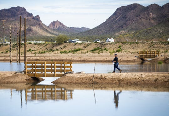 A woman takes the trail during the MAR 5 Interpretive Trail grand opening ceremony near Sacaton, Friday, March 1, 2019.