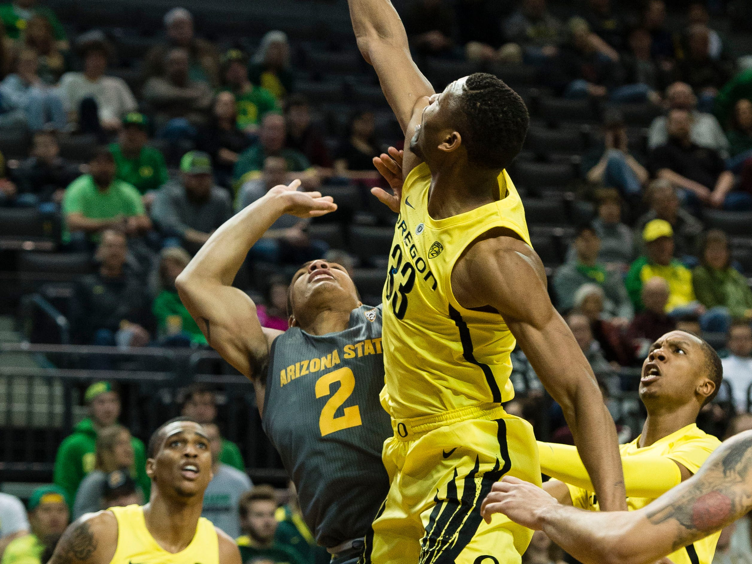 Feb 28, 2019; Eugene, OR, USA; Oregon Ducks forward Francis Okoro (33) blocks a shot by Arizona State Sun Devils guard Rob Edwards (2) during the first half at Matthew Knight Arena.