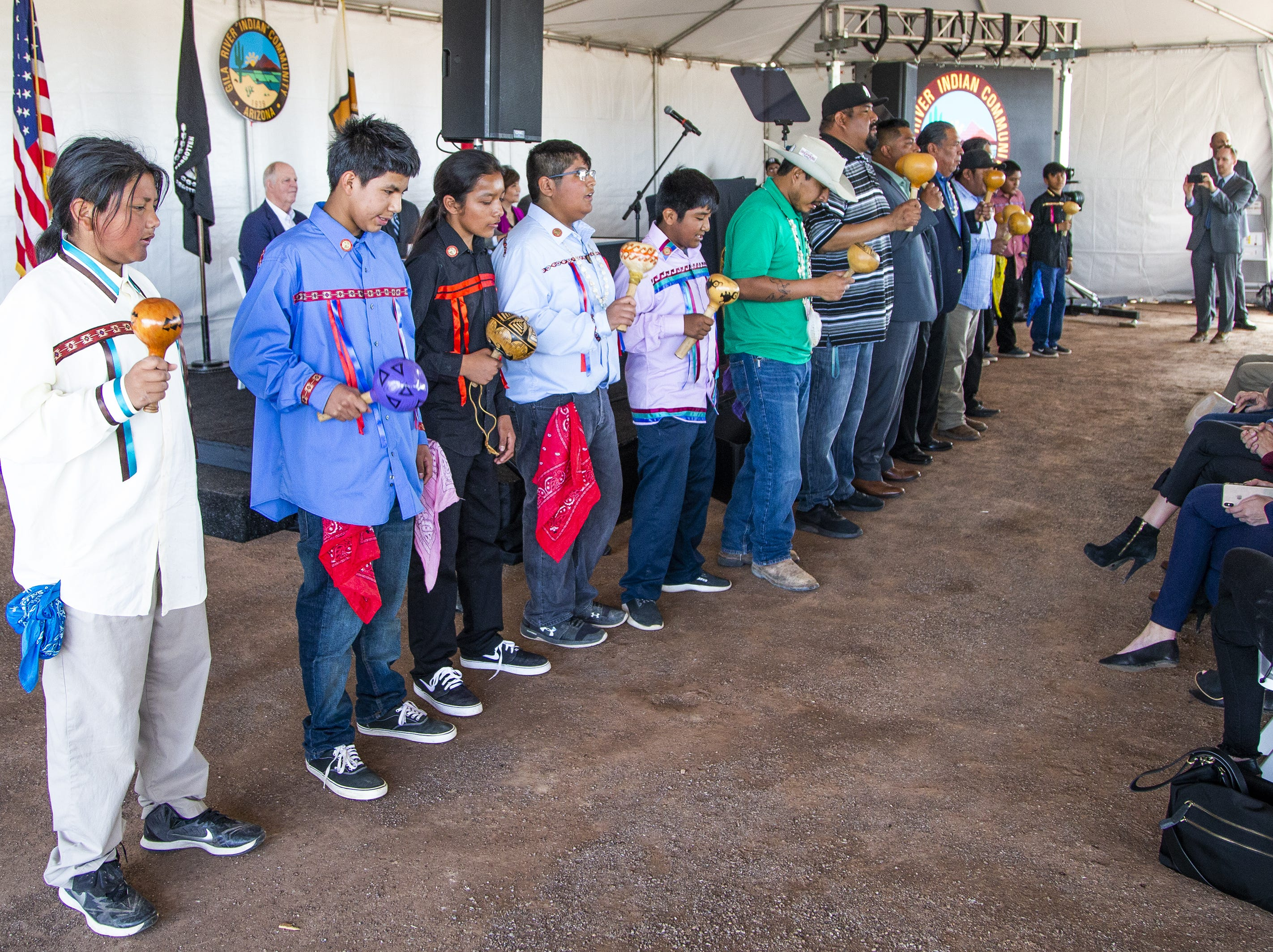 The O'otham Male Singers, including Burton Peters, 11 (left), perform at the MAR 5 Interpretive Trail grand opening ceremony near Sacaton, Friday, March 1, 2019.