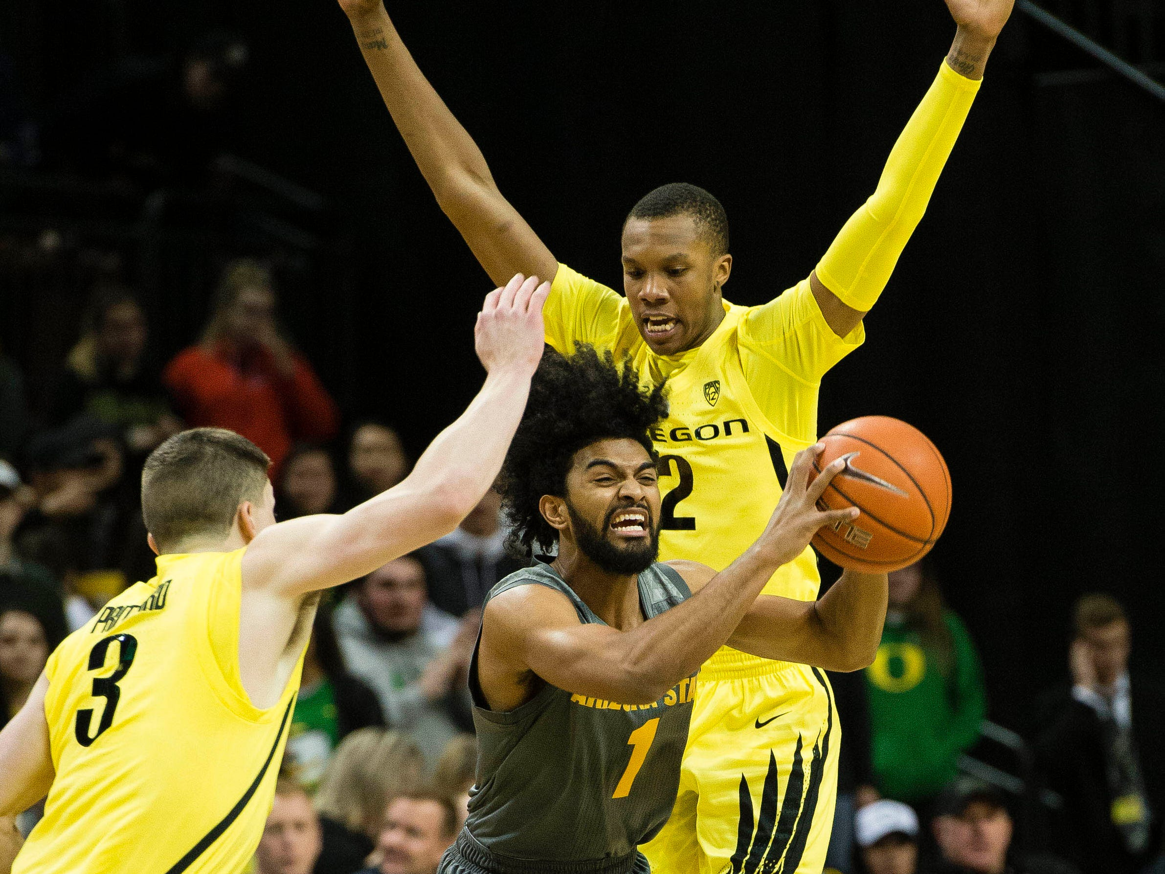 Feb 28, 2019; Eugene, OR, USA; Arizona State Sun Devils guard Remy Martin (1) controls the ball during the first half as Oregon Ducks guard Payton Pritchard (3) and forward Louis King (2) defend at Matthew Knight Arena.
