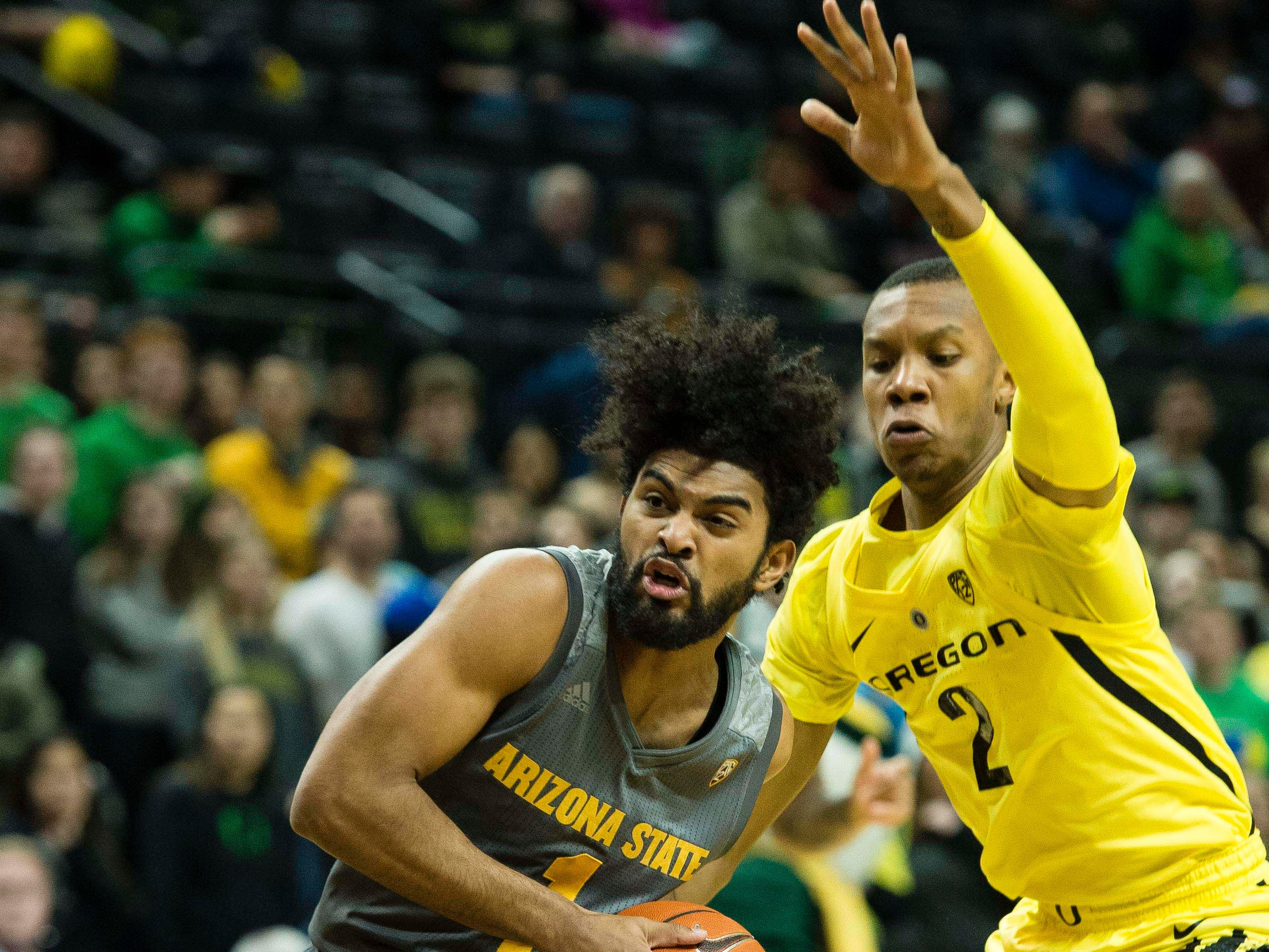 Feb 28, 2019; Eugene, OR, USA; Arizona State Sun Devils guard Remy Martin (1) controls the ball past Oregon Ducks forward Louis King (2) during the first half at Matthew Knight Arena.