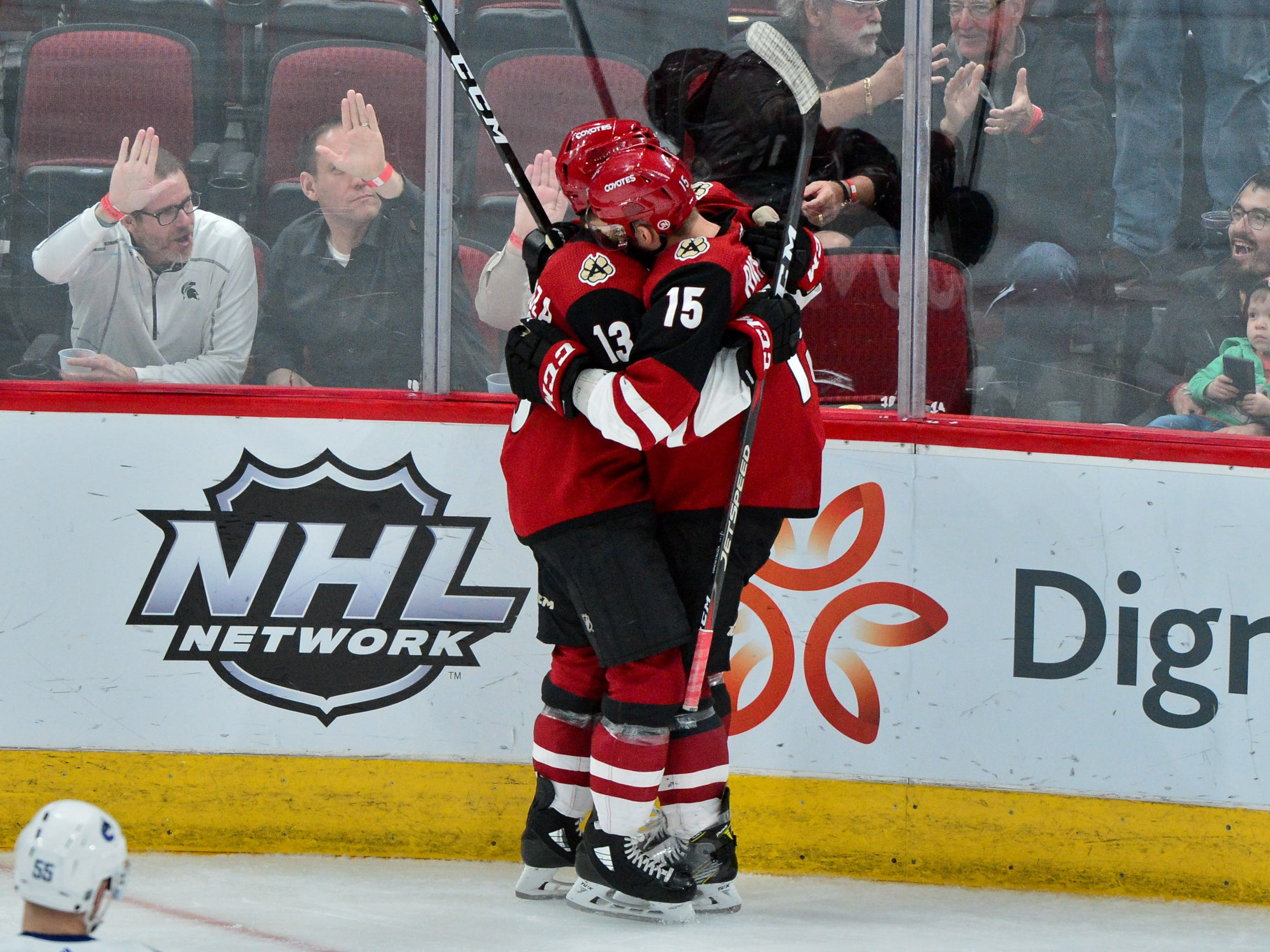 Feb 28, 2019; Glendale, AZ, USA; Arizona Coyotes center Brad Richardson (15) celebrates with center Vinnie Hinostroza (13) after scoring his fourth goal of the game during the third period against the Vancouver Canucks at Gila River Arena.