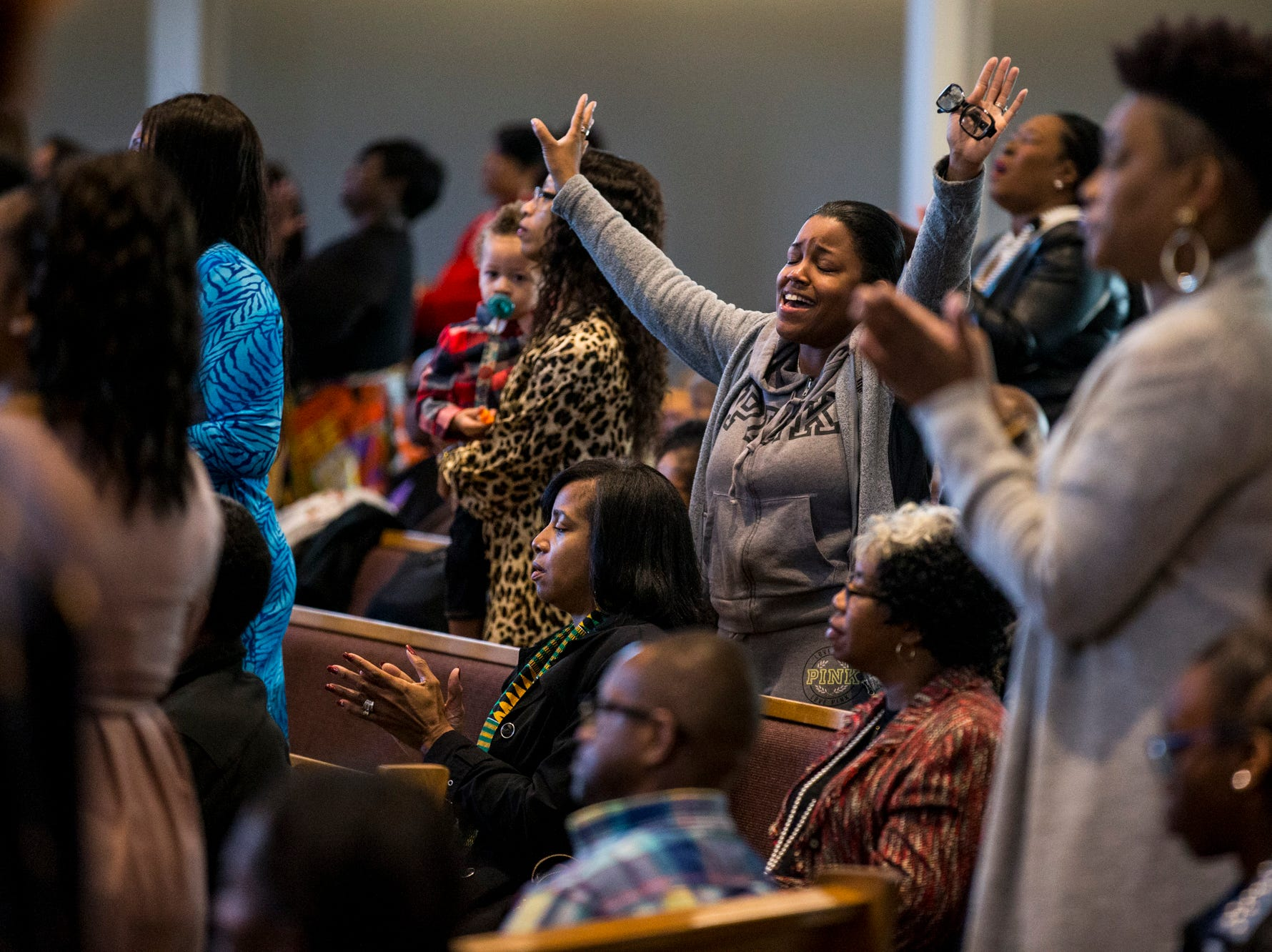 A congregant raises her arms during the 7:30 a.m. service on Feb. 24, 2019, at Pilgrim Rest Baptist Church in Phoenix. Pastor Terry Mackey was appointed to replace the late Bishop Alexis Thomas.