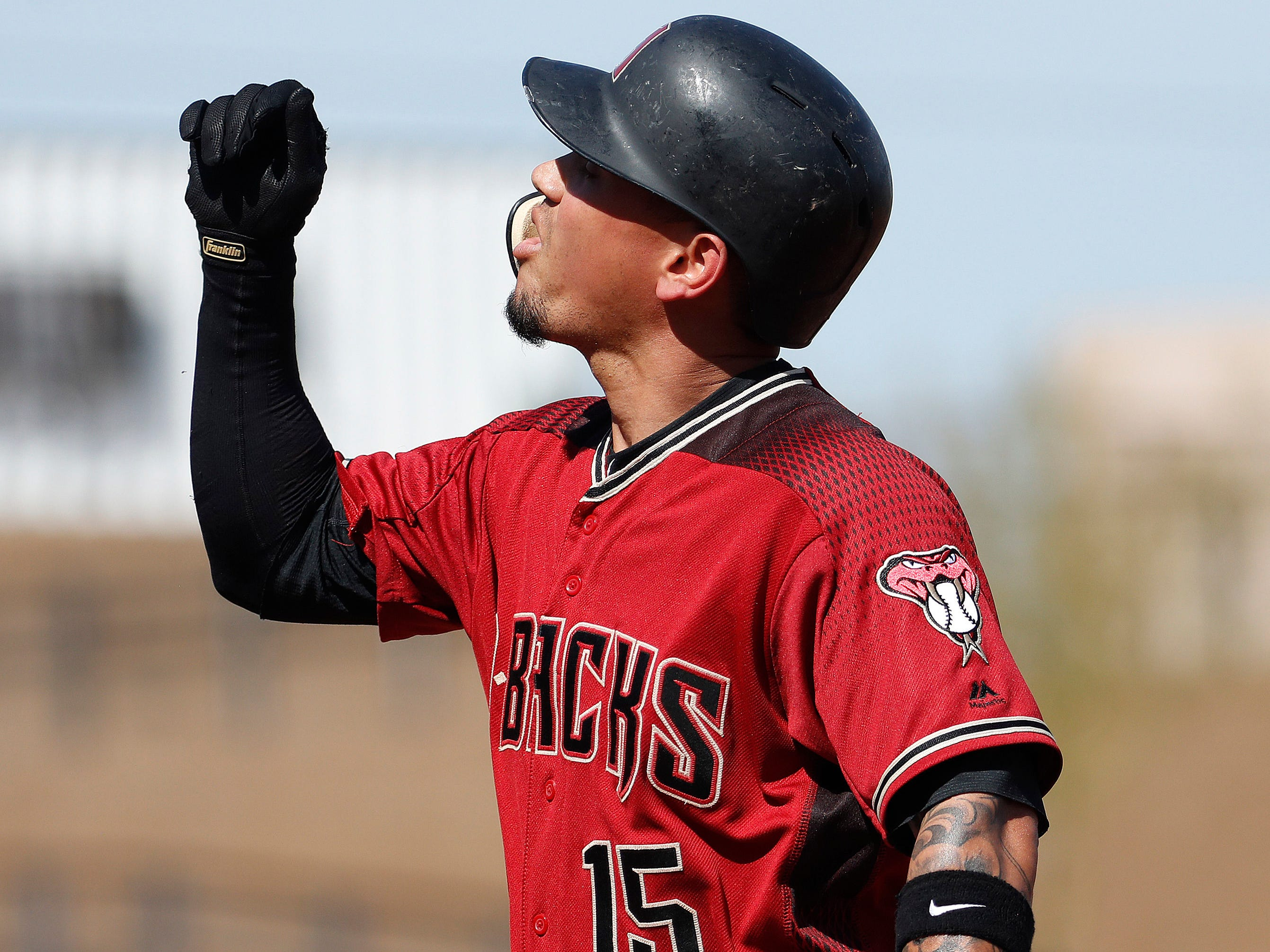 Arizona Diamondbacks' Ildemaro Vargas celebrates a base hit against the Cleveland Indians during the first inning of a spring training baseball game Thursday, Feb. 28, 2019, in Scottsdale, Ariz.