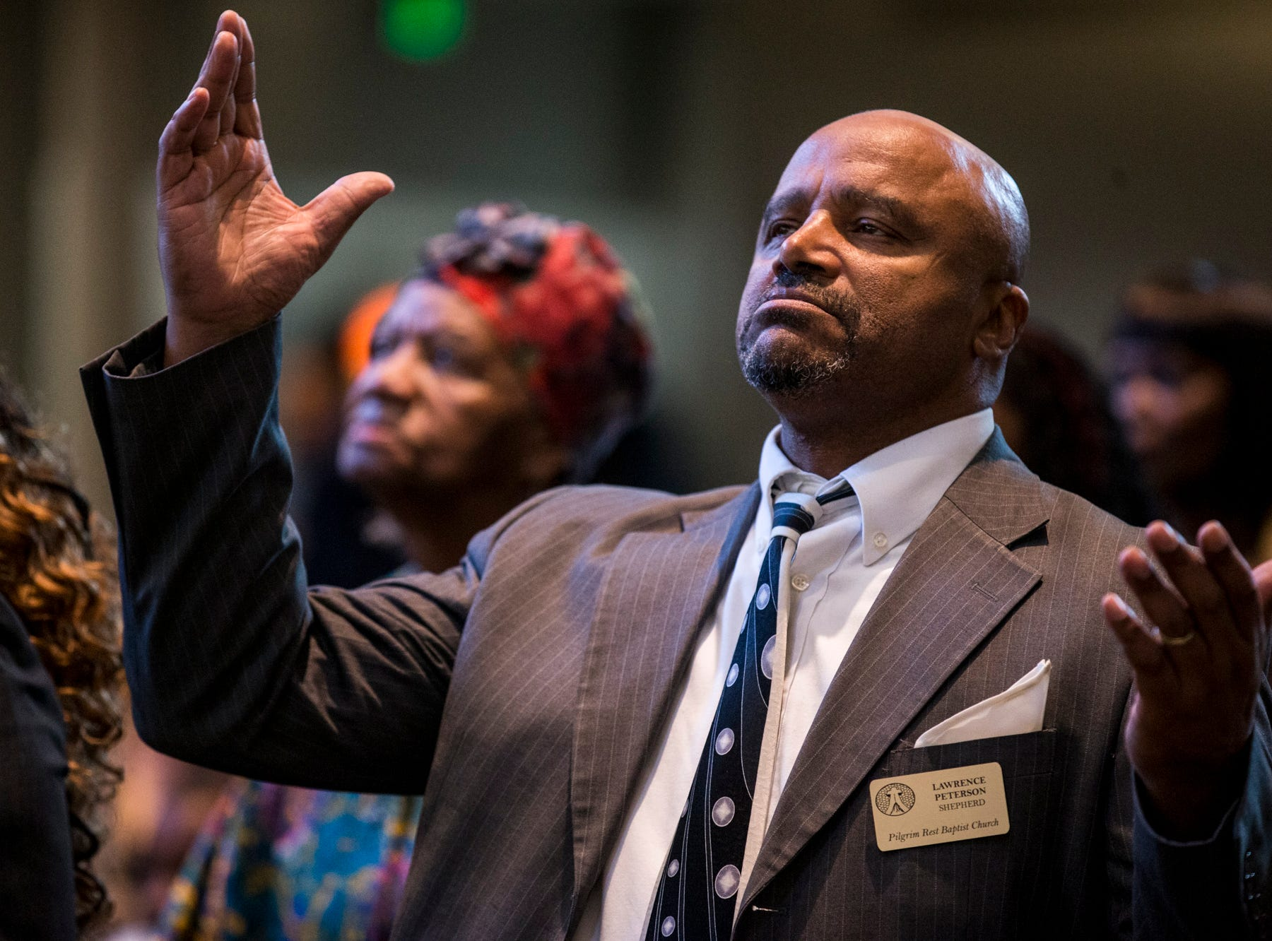 Lawrence Peterson raises his arms during the 7:30 a.m. service on Feb. 24, 2019, at Pilgrim Rest Baptist Church in Phoenix. Pastor Terry Mackey was appointed to replace the late Bishop Alexis Thomas.