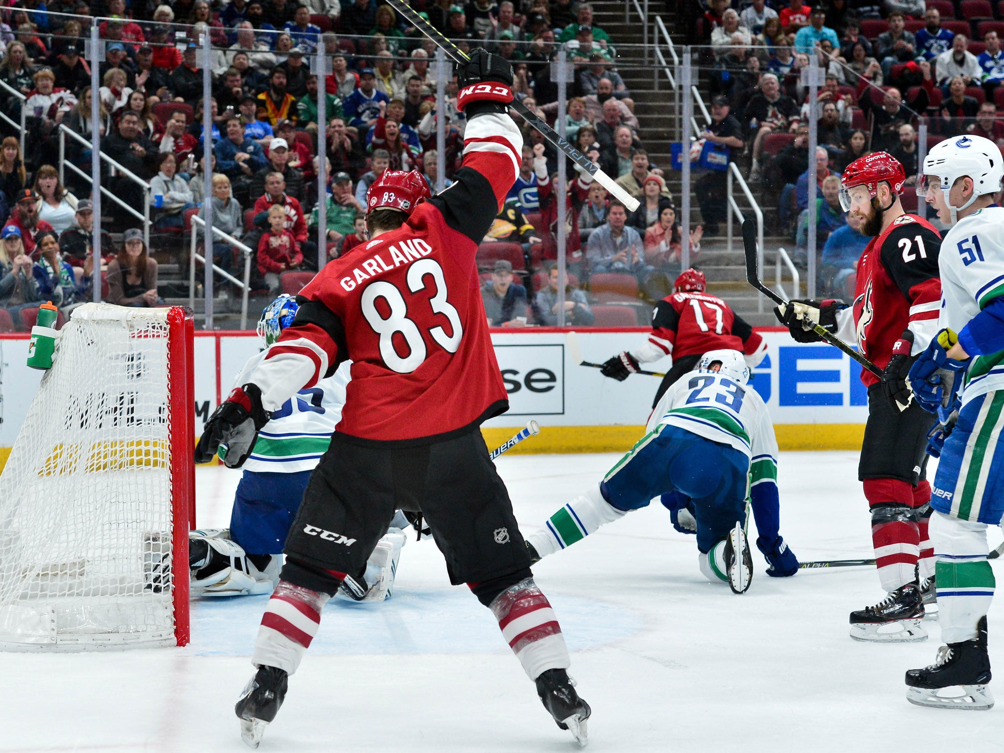 Feb 28, 2019; Glendale, AZ, USA; Arizona Coyotes right wing Conor Garland (83) celebrates a goal by center Alex Galchenyuk (17) during the second period against the Vancouver Canucks at Gila River Arena.