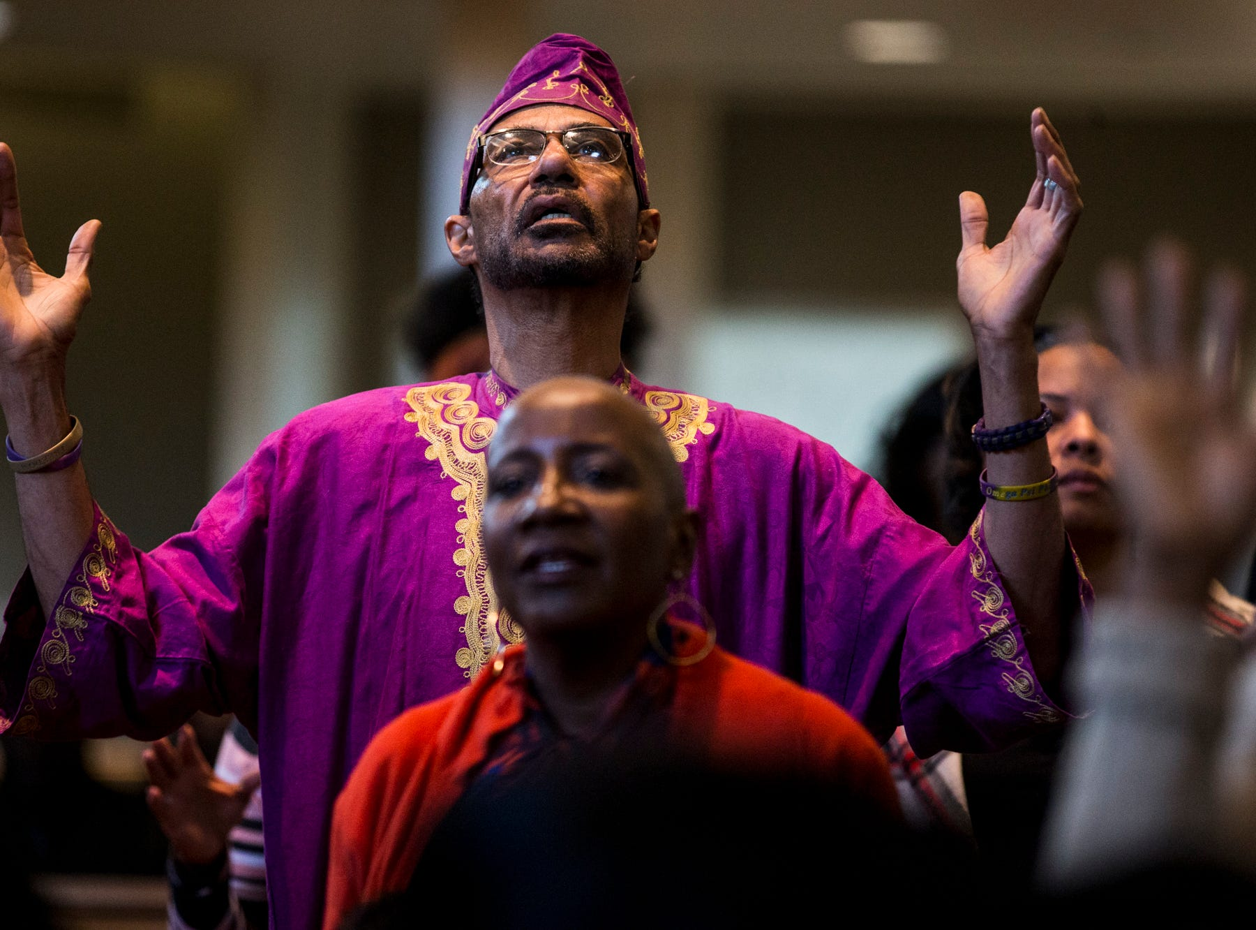 A congregant raises his arms during the 7:30 a.m. service on Feb. 24, 2019, at Pilgrim Rest Baptist Church in Phoenix. Pastor Terry Mackey was appointed to replace the late Bishop Alexis Thomas.