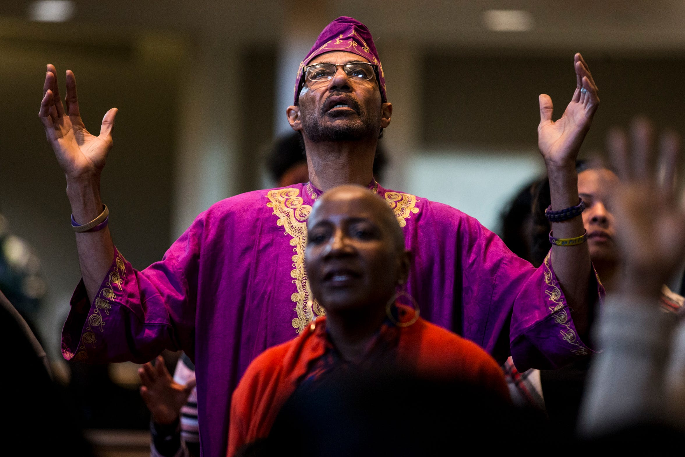 A congregant raises his arms during the 7:30 a.m. service on Feb. 24, 2019, at Pilgrim Rest Baptist Church in Phoenix.