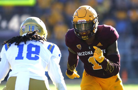 N'Keal Harry takes off from the line of scrimmage while being defended by UCLA's Elijah Gates during the second half of a game Nov. 10 at Sun Devil Stadium..