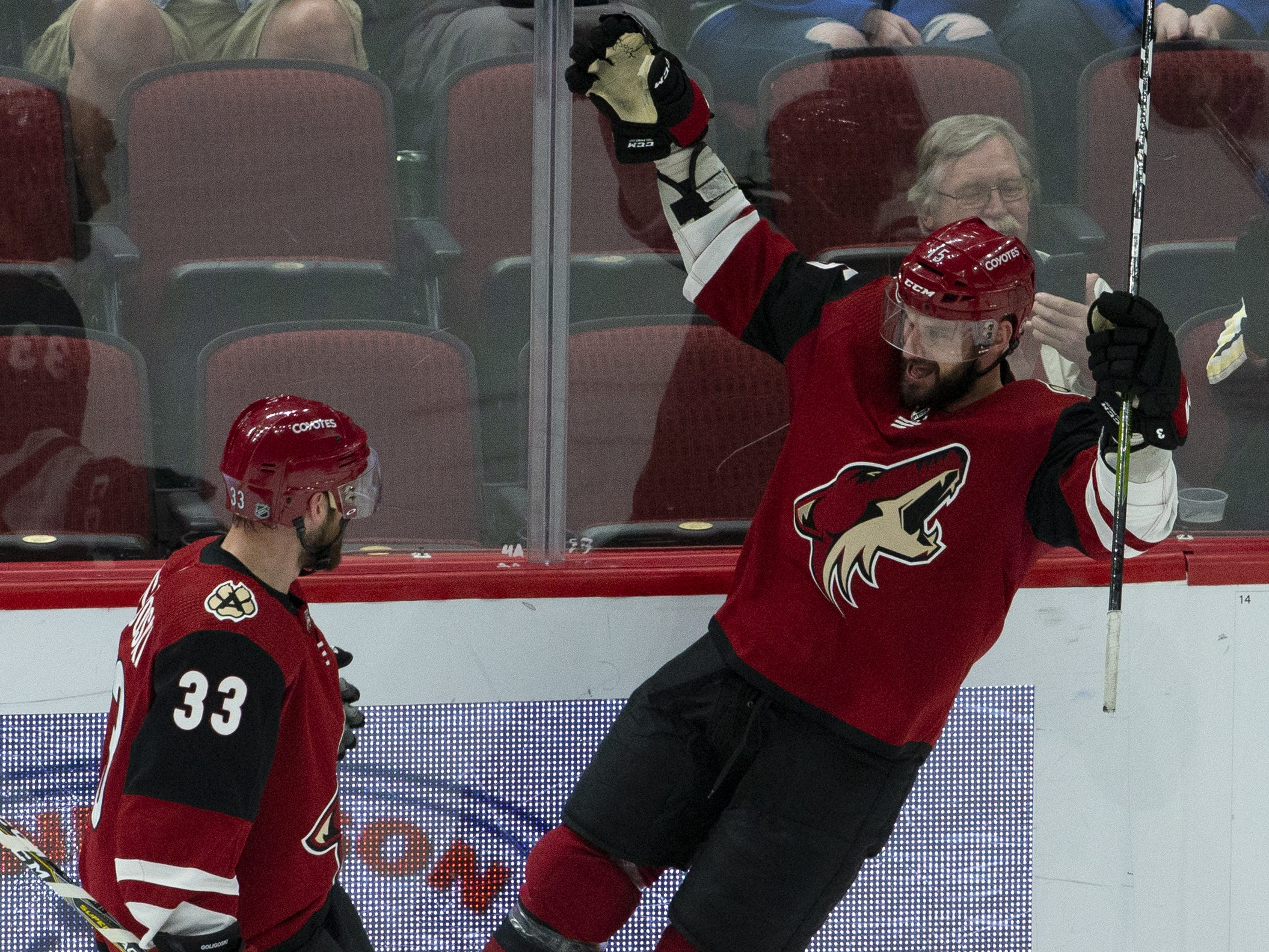 Arizona Coyotes center Brad Richardson (15), right,, celebrates his goal with teammate defenseman Alex Goligoski (33) during a NHL game at Gila River Arena in Glendale on February 28.