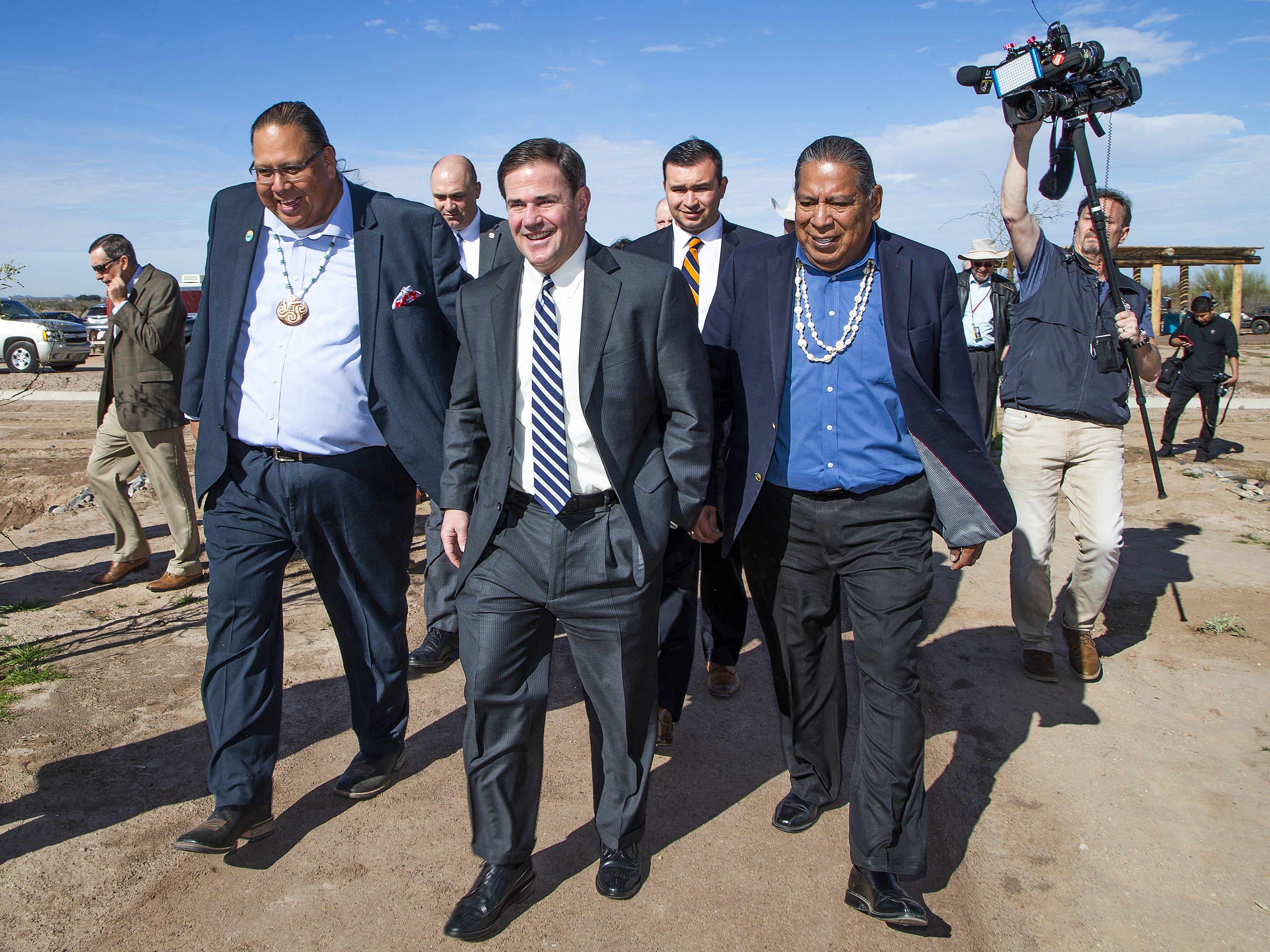 (From left to right) Gila River Indian Community Gov. Stephen Lewis, Arizona Gov. Doug Ducey, and Gila River Indian Community Lt. Gov. Robert Stone walk to the Mar 5 Interpretive Trail grand-opening ceremony near Sacaton on March 1, 2019.