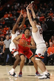 Arizona's Ira Lee (11) fights through Oregon State's Alfred Hollins (4), left, and Gligorije Rakocevic (23), right, during the first half of an NCAA college basketball game in Corvallis, Ore., Thursday, Feb. 28, 2019.