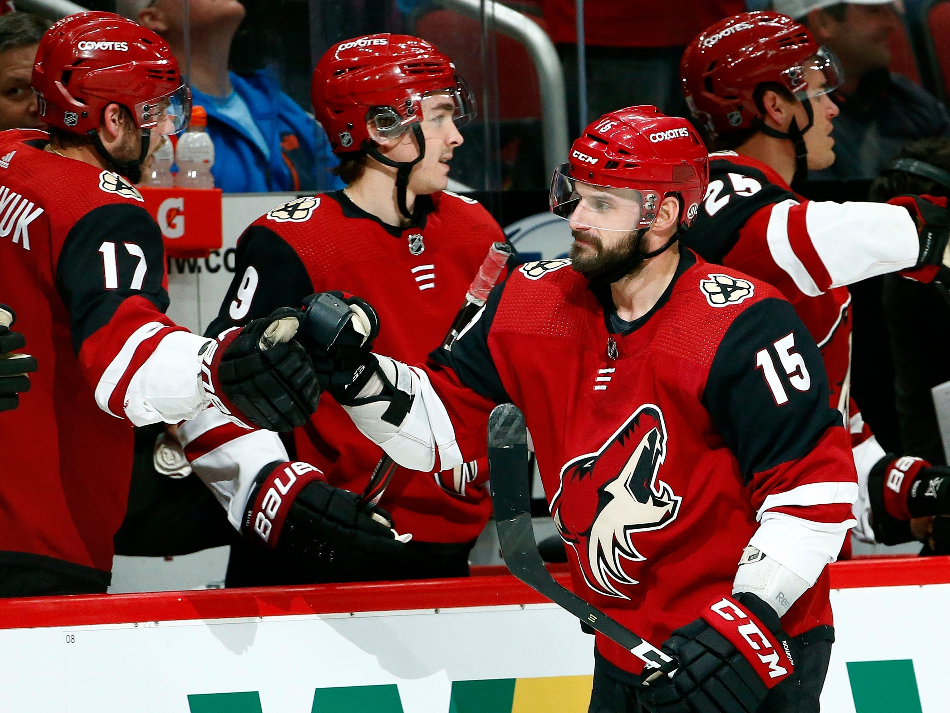Arizona Coyotes center Brad Richardson (15) celebrates his second goal against the Vancouver Canucks during the first period of an NHL hockey game with Coyotes center Alex Galchenyuk (17), center Clayton Keller (9) and center Nick Cousins (25) Thursday, Feb. 28, 2019, in Glendale, Ariz.