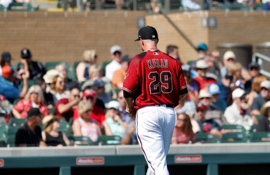 Arizona Diamondbacks starting pitcher Merrill Kelly is pulled from the game after allowing three runs during the first inning of the team's spring training baseball game against the Cleveland Indians, Thursday, Feb. 28, 2019, in Scottsdale, Ariz.