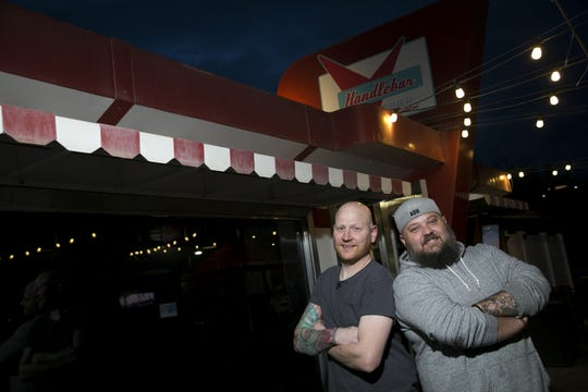 Mat Meyers (left) a chef at Handlebar diner stands next the diner's owner Adam Allison (right) in front of the restaurant in Mesa, Arizona on Wednesday, February 13, 2019.