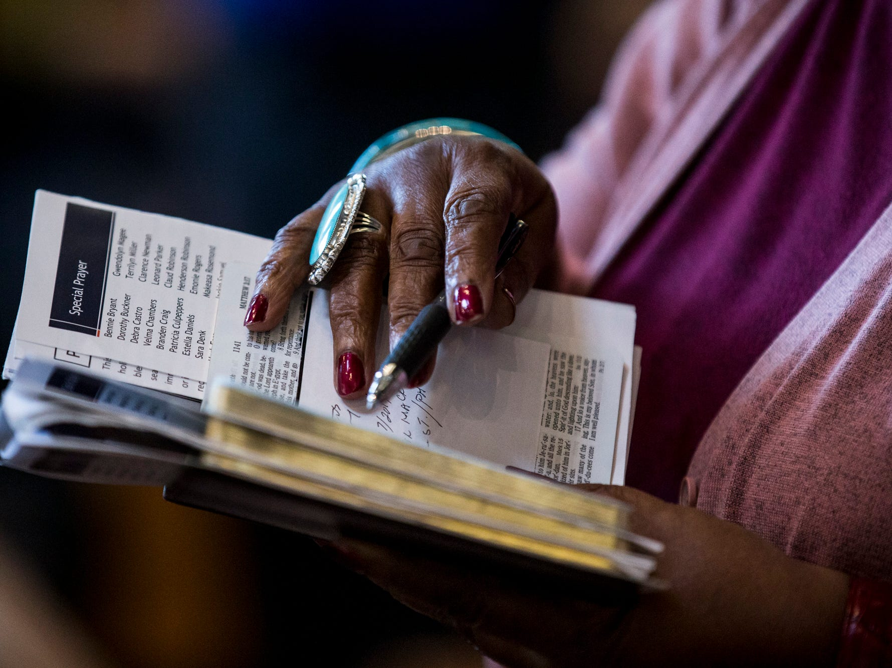 A congregant follows along in her Bible during the 7:30 a.m. service on Feb. 24, 2019, at Pilgrim Rest Baptist Church in Phoenix. Pastor Terry Mackey was appointed to replace the late Bishop Alexis Thomas.