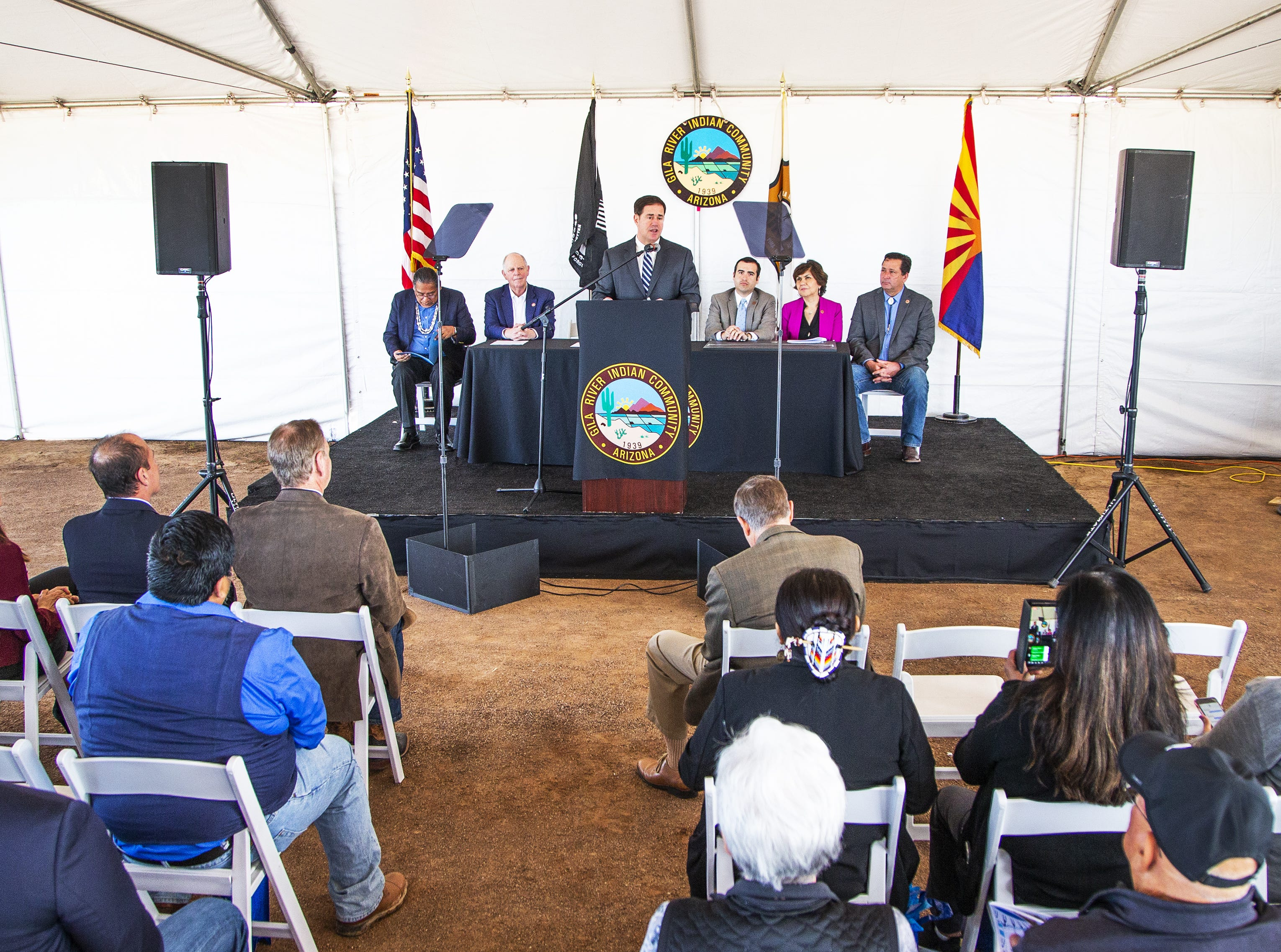 Gov. Doug Ducey makes remarks to the crowd at the MAR 5 Interpretive Trail grand opening ceremony near Sacaton, Friday, March 1, 2019.