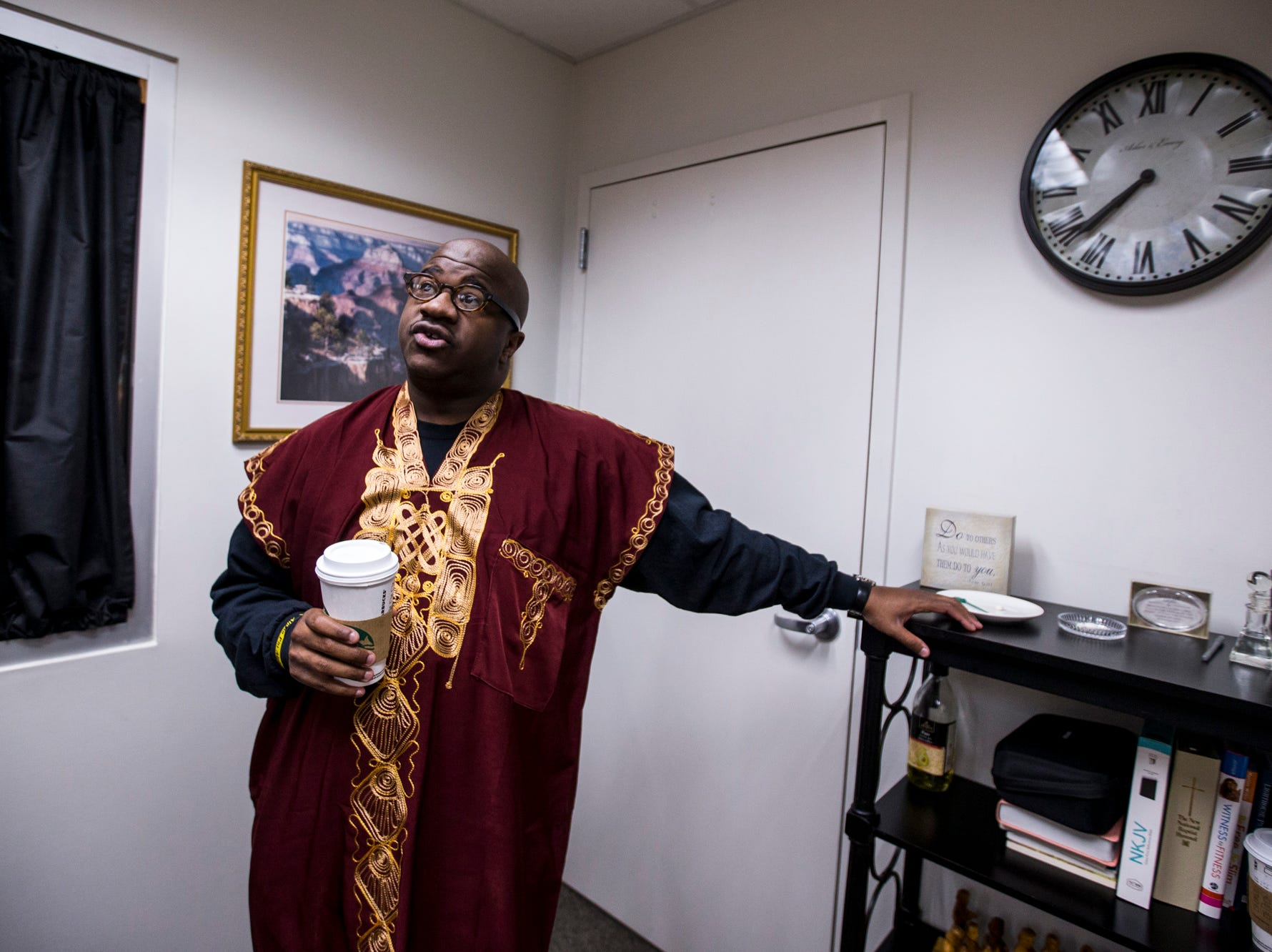 Pastor Terry Mackey prepares for the 7:30 a.m. service in the vestry on Feb. 24, 2019, at Pilgrim Rest Baptist Church in Phoenix. Mackey was appointed to replace the late Bishop Alexis Thomas.