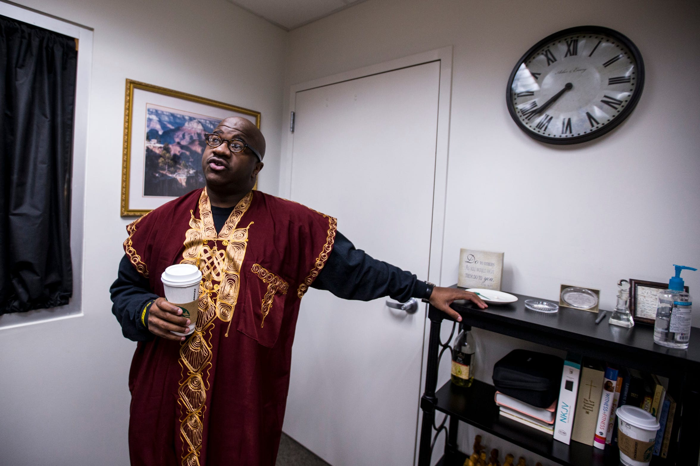 Starbucks in hand, Pastor Terry Mackey prepares for the 7:30 a.m. service at Pilgrim Rest Baptist Church in Phoenix.
