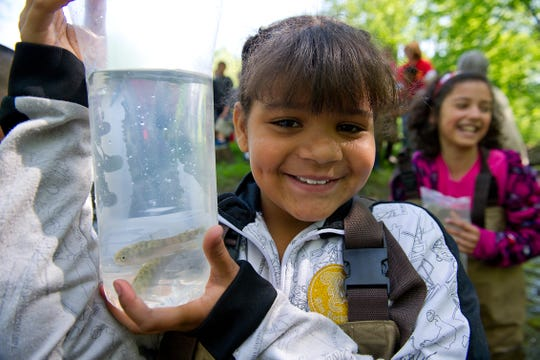 """Gier Park school """"Salmon in the Classroom"""" release, Sycamore Creek, Lansing.Makalia Olive, age 10."""