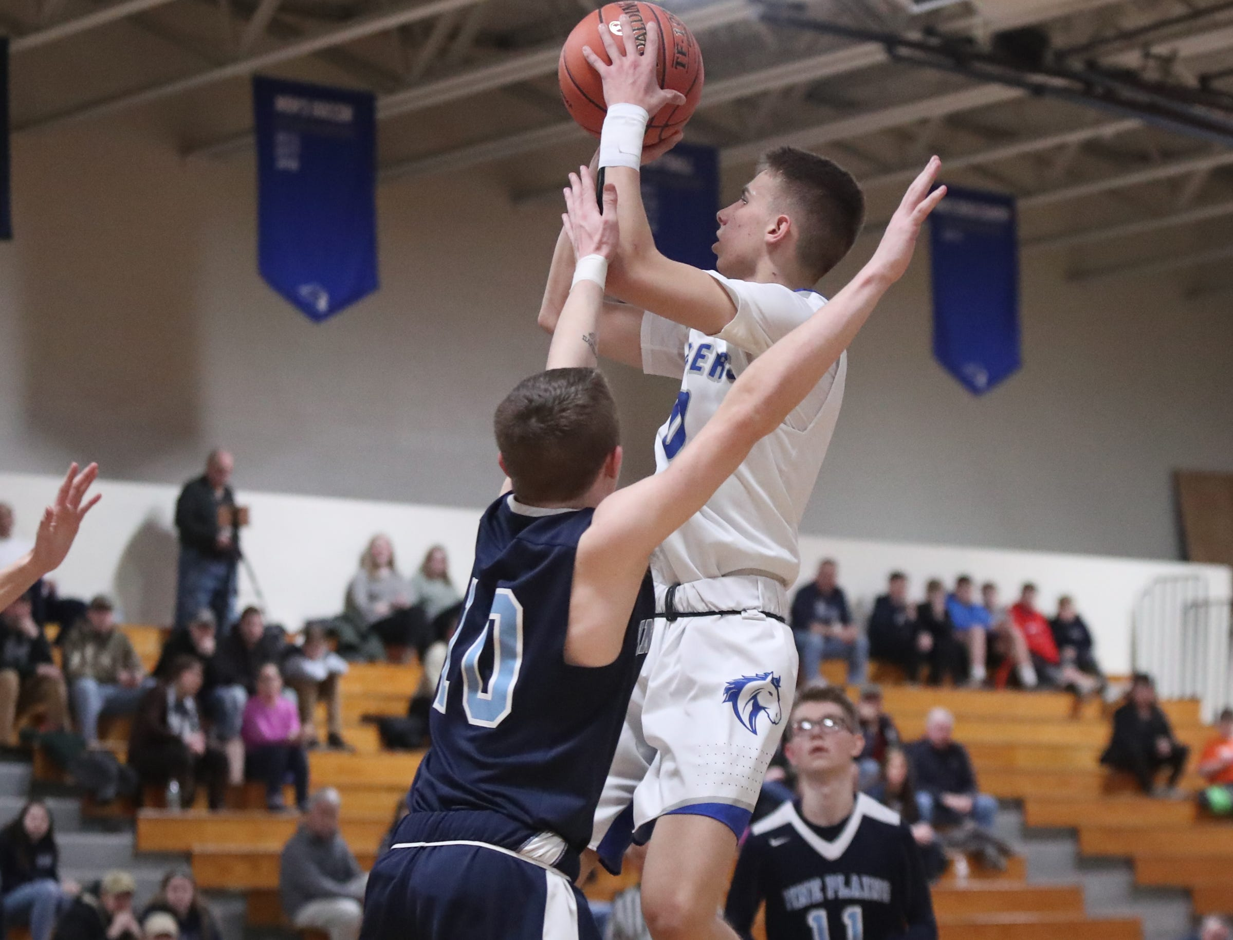 Millbrook's Jake Daly (0) drives on Pine Plains' Calab McCaul (10) in the boys basketball Class C section final basketball game at Mount St. Mary College in Newburgh on Thursday, February 28, 2019.