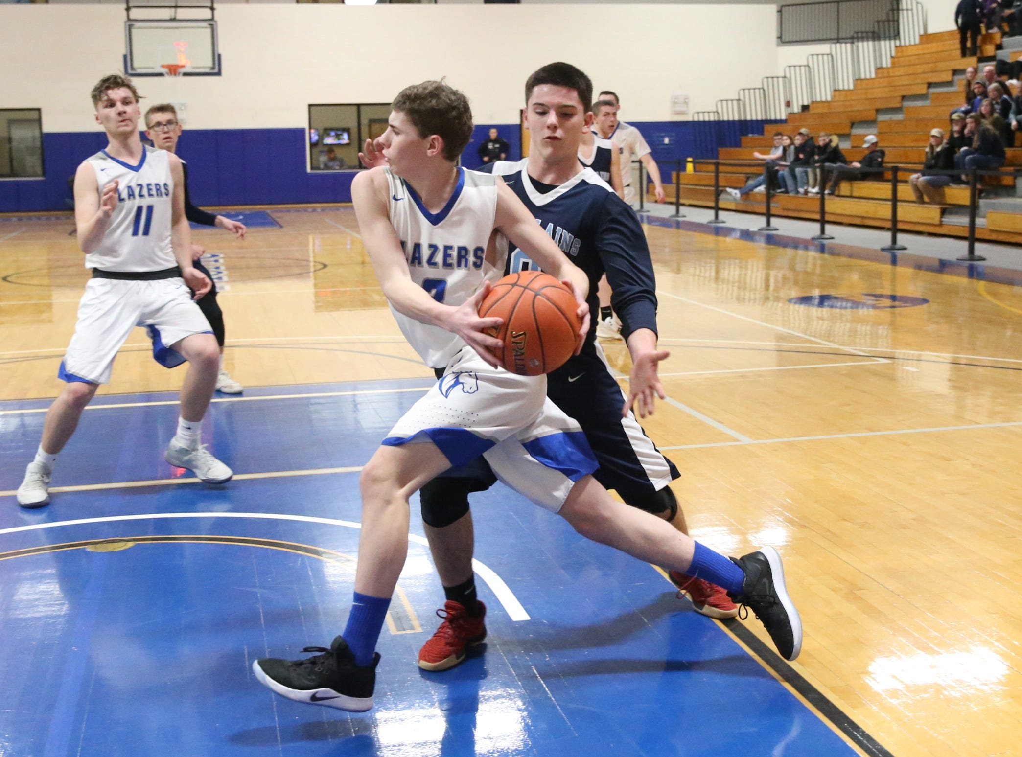Sebastian Kopilak (3) dribes the baseline against Pine Plains' Evan Proper (0) in the boys Class C section final basketball game at Mount St. Mary College in Newburgh on Thursday, February 28, 2019.