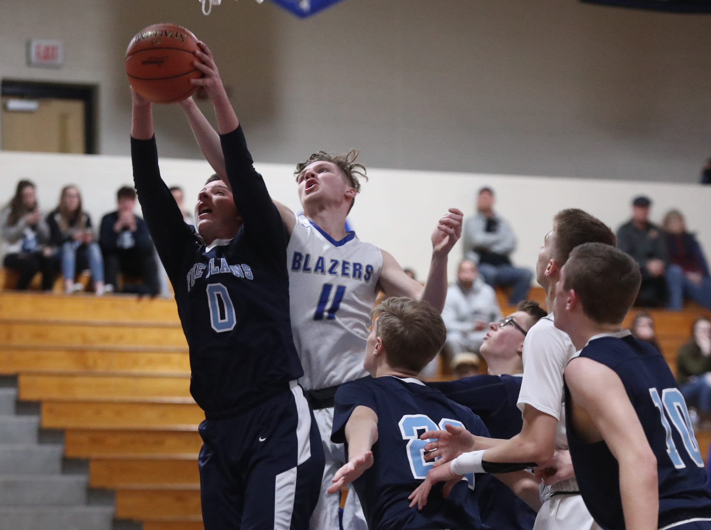 Pine Plains' Evan Proper (0) and Millbrook's Steven Szalwicz (11) battle for a rebound in the boys Class C section final basketball game at Mount St. Mary College in Newburgh on Thursday, February 28, 2019.