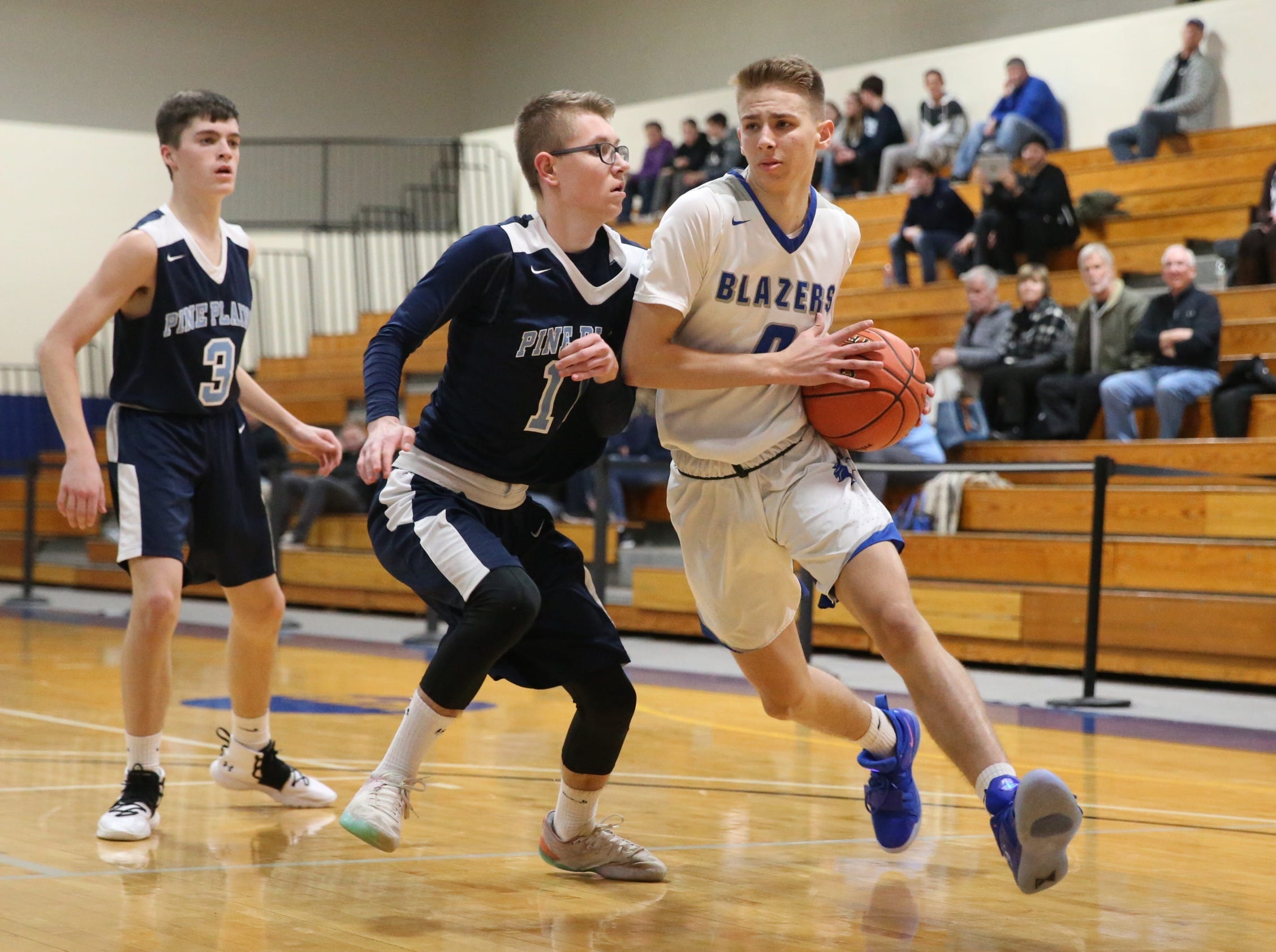 Millbrook's Jake Daly (0) drives on Pine Plains' Caleb McCaul (11) in the boys Class C section final basketball game at Mount St. Mary College in Newburgh on Thursday, February 28, 2019.