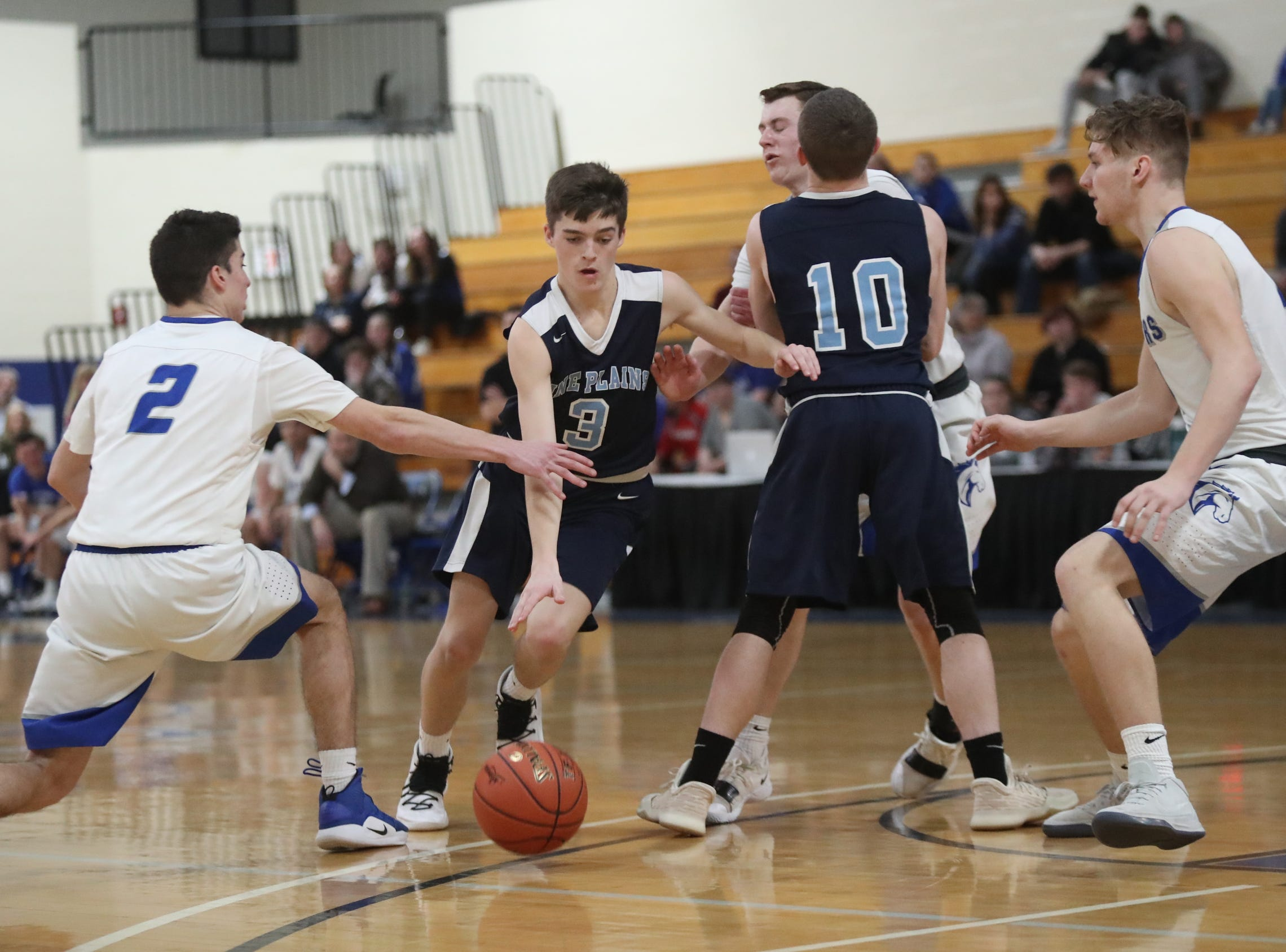Millbrook defeats Pine Plains 72-58 in the boys Class C section final basketball game at Mount St. Mary College in Newburgh on Thursday, February 28, 2019.