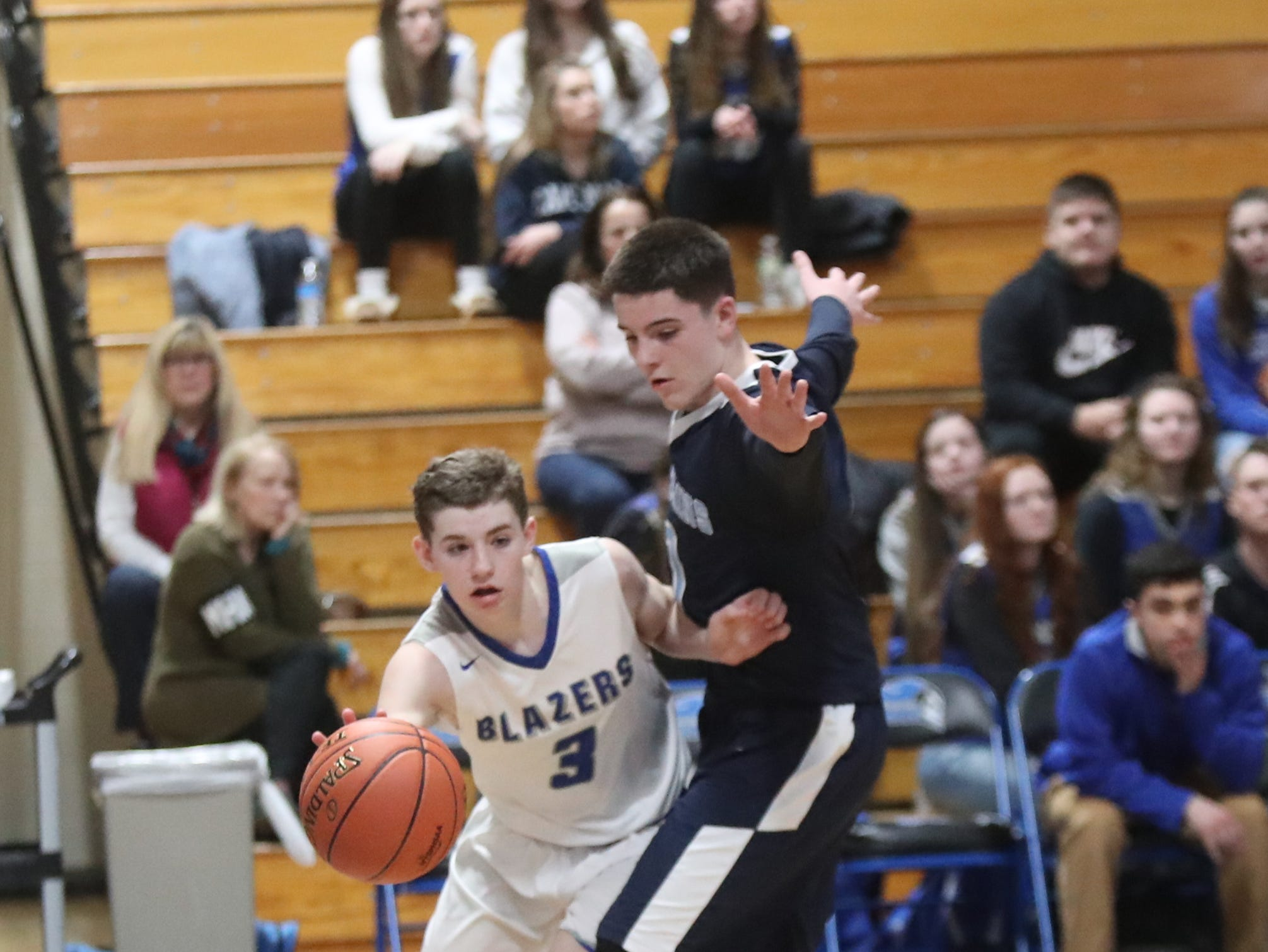 Sebastian Kopilak (3) works the baseline in the boys Class C section final basketball game against Pine Plains at Mount St. Mary College in Newburgh on Thursday, February 28, 2019.
