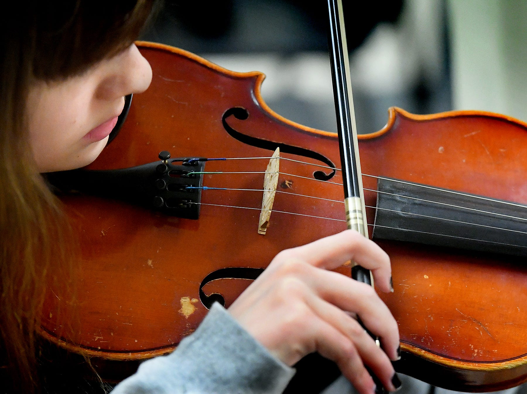 """Red Lion student Madison Lester plays violin during an orchestra rehearsal at the school Friday, March 1, 2019. The orchestra is fine-tuning """"Obsidian Rainbow"""" which was written by Red Lion graduate and New York composer Derek Cooper. He is premiering the piece via the Red Lion Area High School string orchestra on Wednesday, March 6. Cooper will be at the school working with the orchestra beforehand. Bill Kalina photo"""