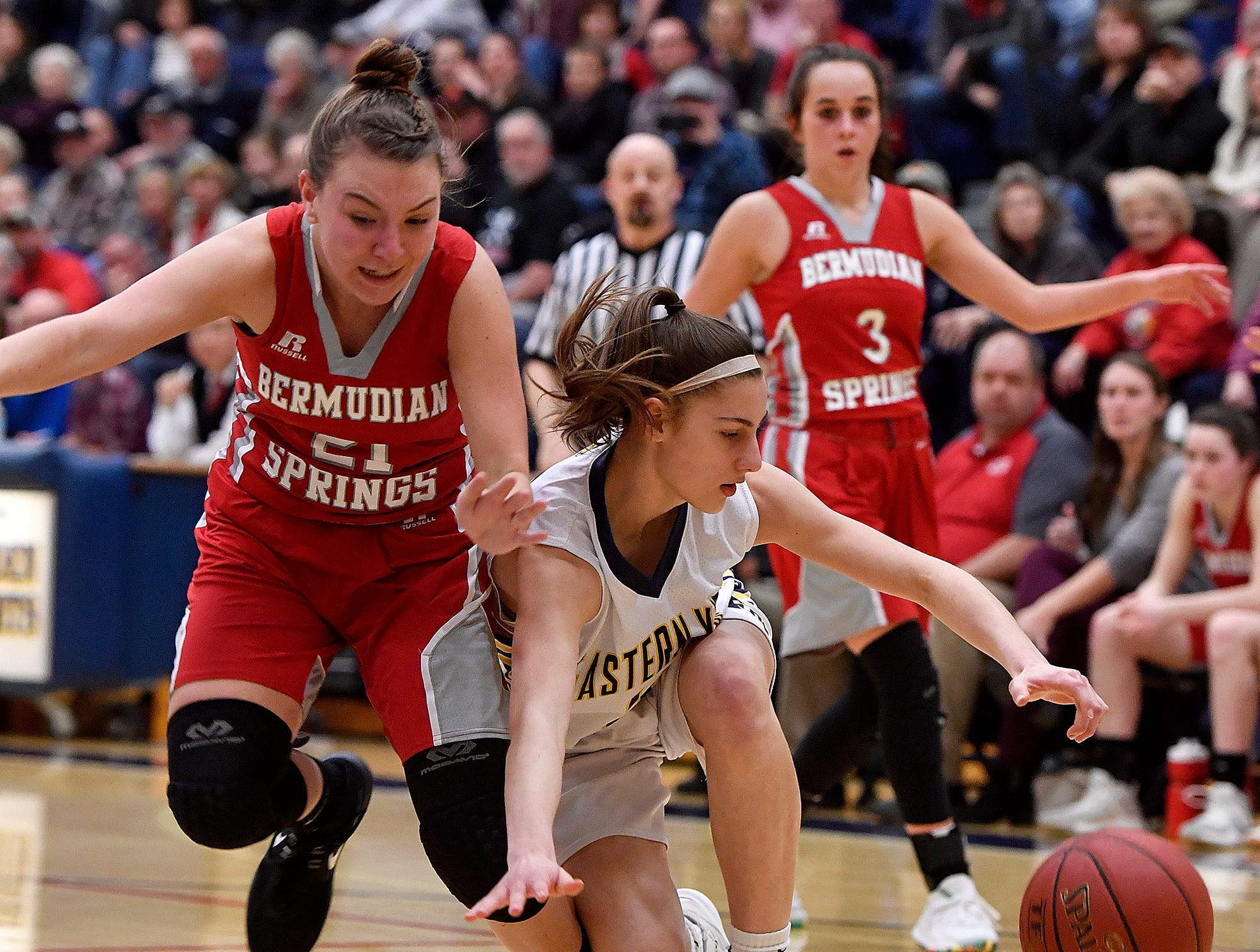 Bermudian Springs'a Keri Spealman blocks Victoria Zerbe of Eastern York as she stumbles with the ball during the District 3 Class 4-A fifth place basketball game, Thursday, Feb. 28, 2019.John A. Pavoncello photo