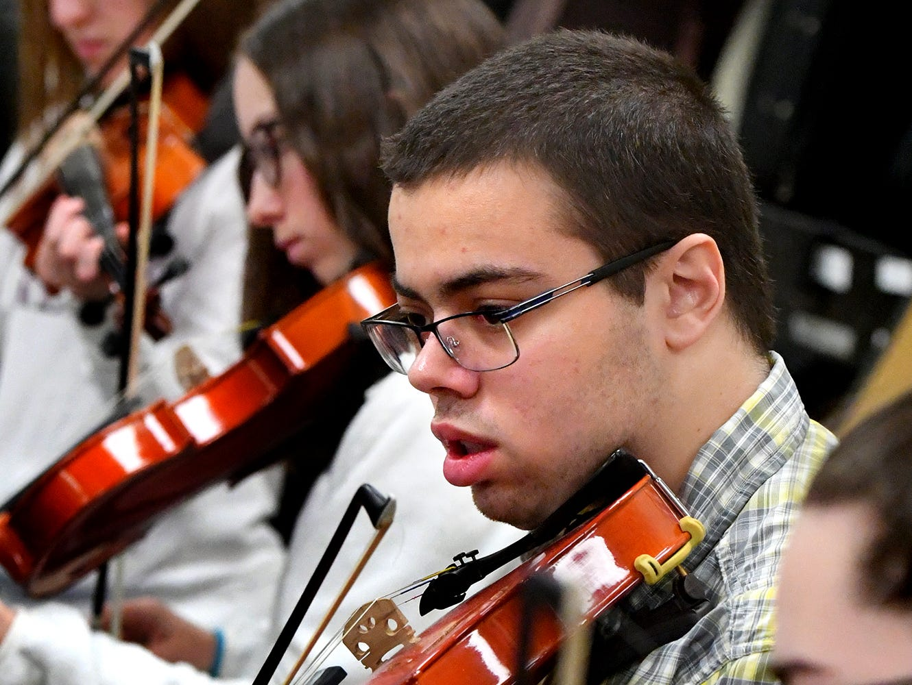 """Red Lion student Chance Riddle plays violin during an orchestra rehearsal at the school Friday, March 1, 2019. The orchestra is fine-tuning """"Obsidian Rainbow"""" which was written by Red Lion graduate and New York composer Derek Cooper. He is premiering the piece via the Red Lion Area High School string orchestra on Wednesday, March 6. Cooper will be at the school working with the orchestra beforehand. Bill Kalina photo"""