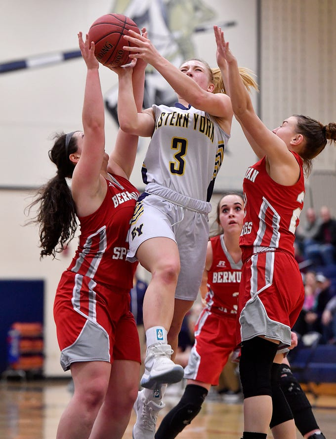 Cassidy Arnold of Eastern York drives through Bermudian Springs defenders Emily Shearer, left and Keri Spealman during the District 3 Class 4-A fifth place game, Thursday, Feb. 28, 2019.John A. Pavoncello photo