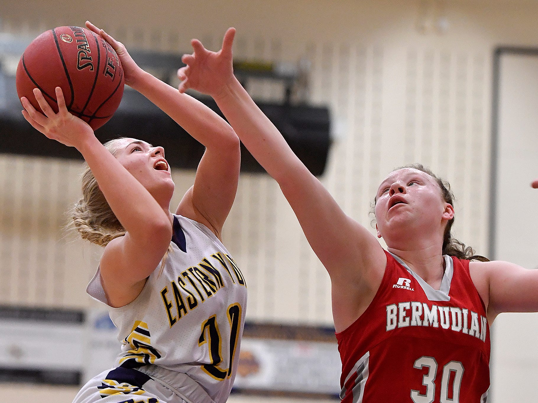 Breana Grim of Eastern York drives to the basket while covered by Hannah Chenault of Bermudian Springs during the District 3 Class 4-A fifth place basketball game, Thursday, Feb. 28, 2019.John A. Pavoncello photo
