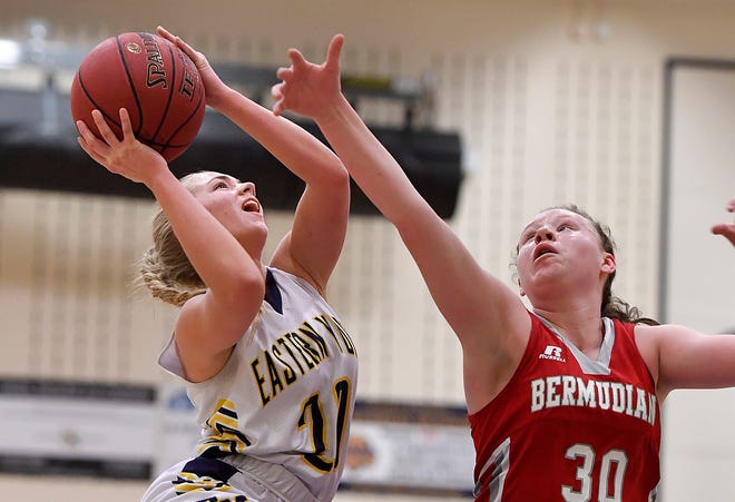 Bermudian Springs' Hannah Chenault, right, tries to block a shot by Eastern York's Breana Grim last season. Chenault is the leading scorer (15.8 points per game) for the unbeaten Eagles (8-0) this season. John A. Pavoncello photo