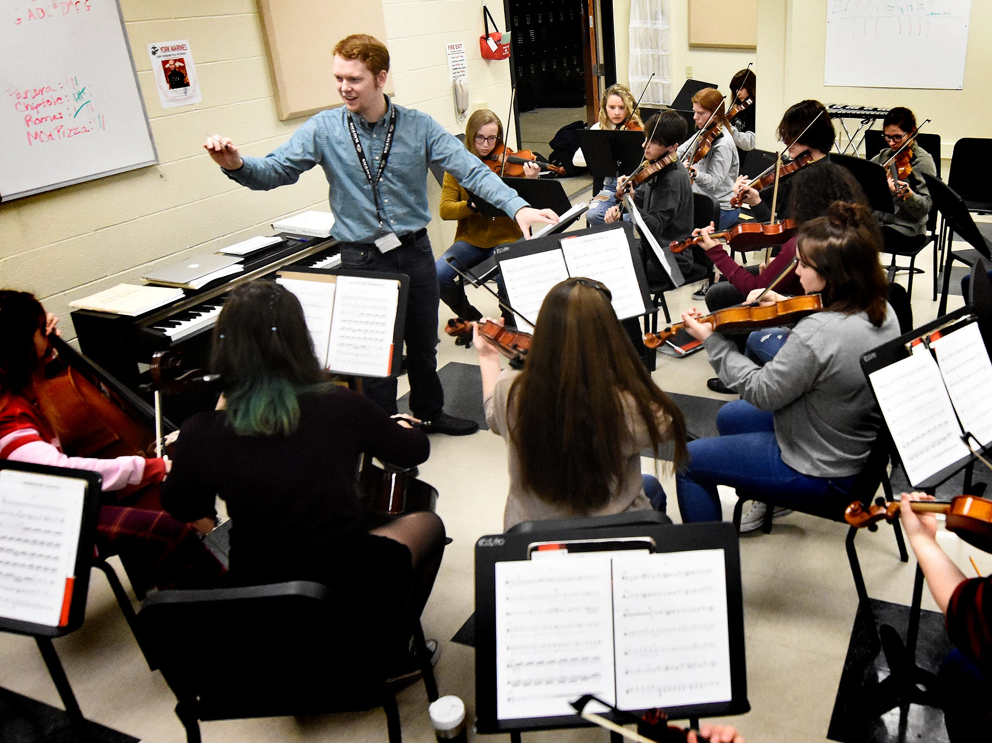 """Red Lion orchestra director Scott Kaliszak leads a rehearsal at the school Friday, March 1, 2019. The orchestra is working on """"Obsidian Rainbow"""" which was written by Red Lion graduate and New York composer Derek Cooper. He is premiering the piece via the Red Lion Area High School string orchestra on Wednesday, March 6. Cooper will be at the school working with the orchestra beforehand. Bill Kalina photo"""