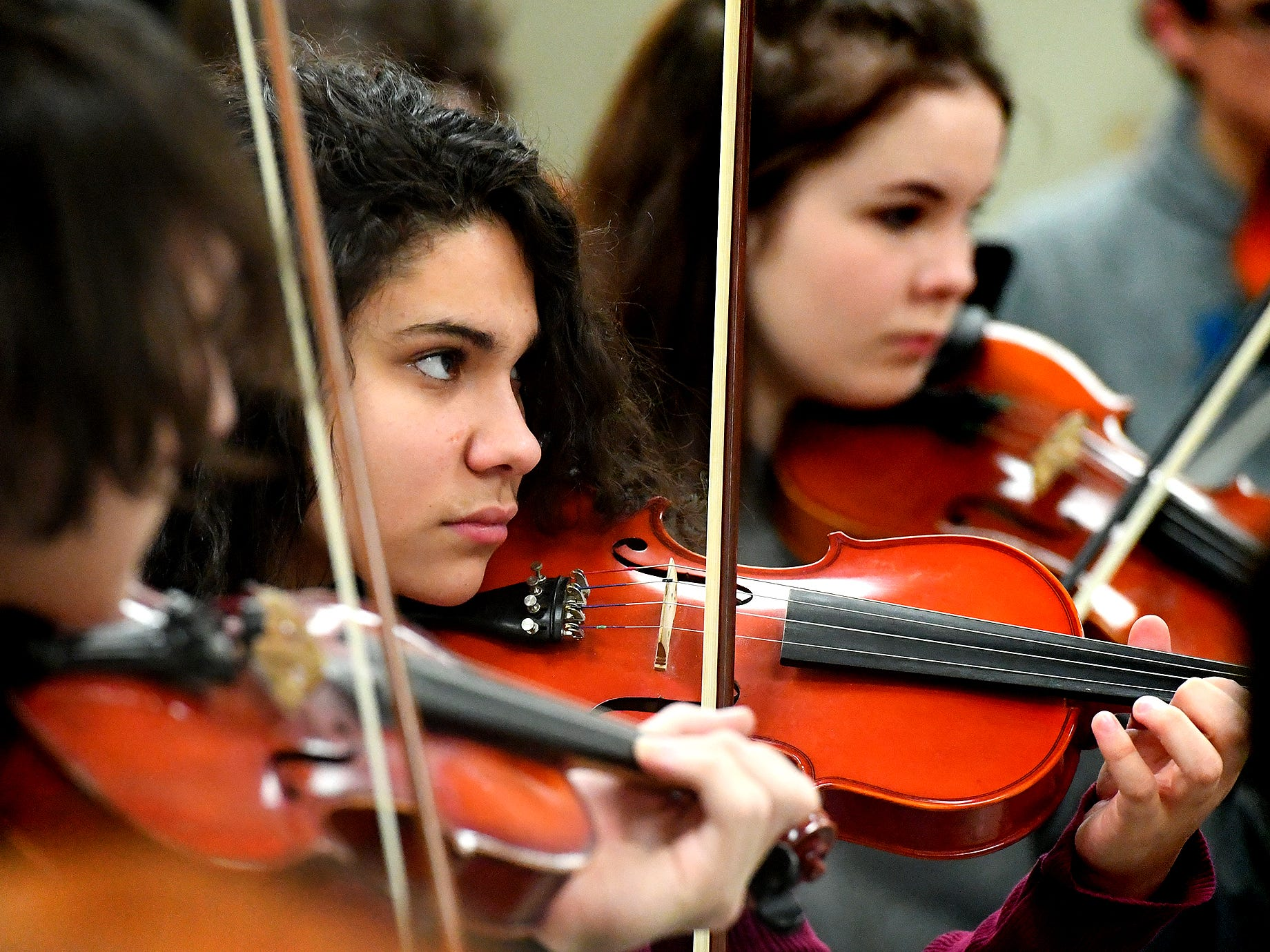 """Red Lion senior Keila Vazquez-Perez plays violin during an orchestra rehearsal at the school Friday, March 1, 2019. The orchestra is fine-tuning the piece """"Obsidian Rainbow"""" which was written by Red Lion graduate and New York composer Derek Cooper. He is premiering the piece via the Red Lion Area High School string orchestra on Wednesday, March 6. Cooper will be at the school working with the orchestra beforehand. Bill Kalina photo"""