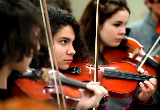 "Red Lion senior Keila Vazquez-Perez plays violin during an orchestra rehearsal at the school Friday, March 1, 2019. The orchestra is fine-tuning the piece ""Obsidian Rainbow"" which was written by Red Lion graduate and New York composer Derek Cooper. He is premiering the piece via the Red Lion Area Senior High School string orchestra on Wednesday, March 6. Cooper will be at the school working with the orchestra beforehand. Bill Kalina photo"