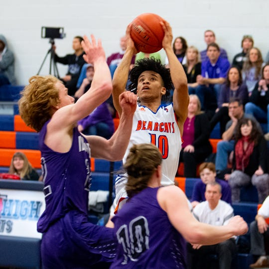 Jaevon Woodyard (10) shoots in traffic during the District 3 third-place game between York High and Northern York on Thursday in York. The Bearcats won, 86-68.