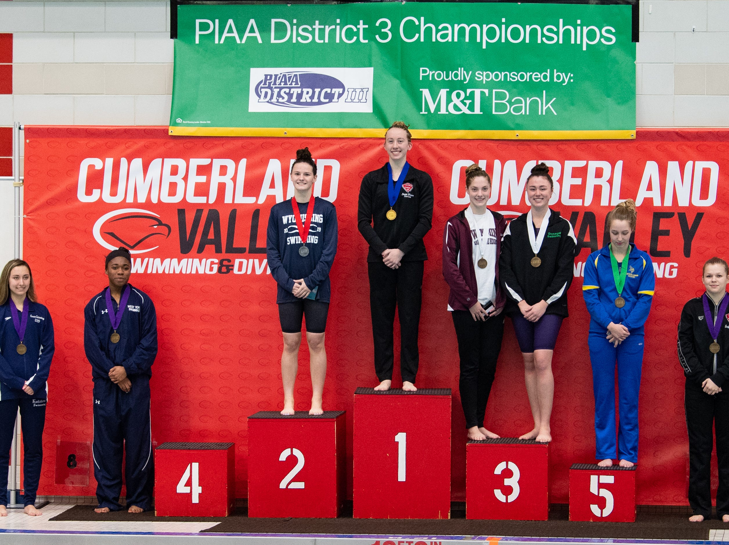 The winners of the Girls 50 Yard Freestyle accept their medals during the PIAA District 3 Girls AA Championship, March 1, 2019 at Cumberland Valley High School.