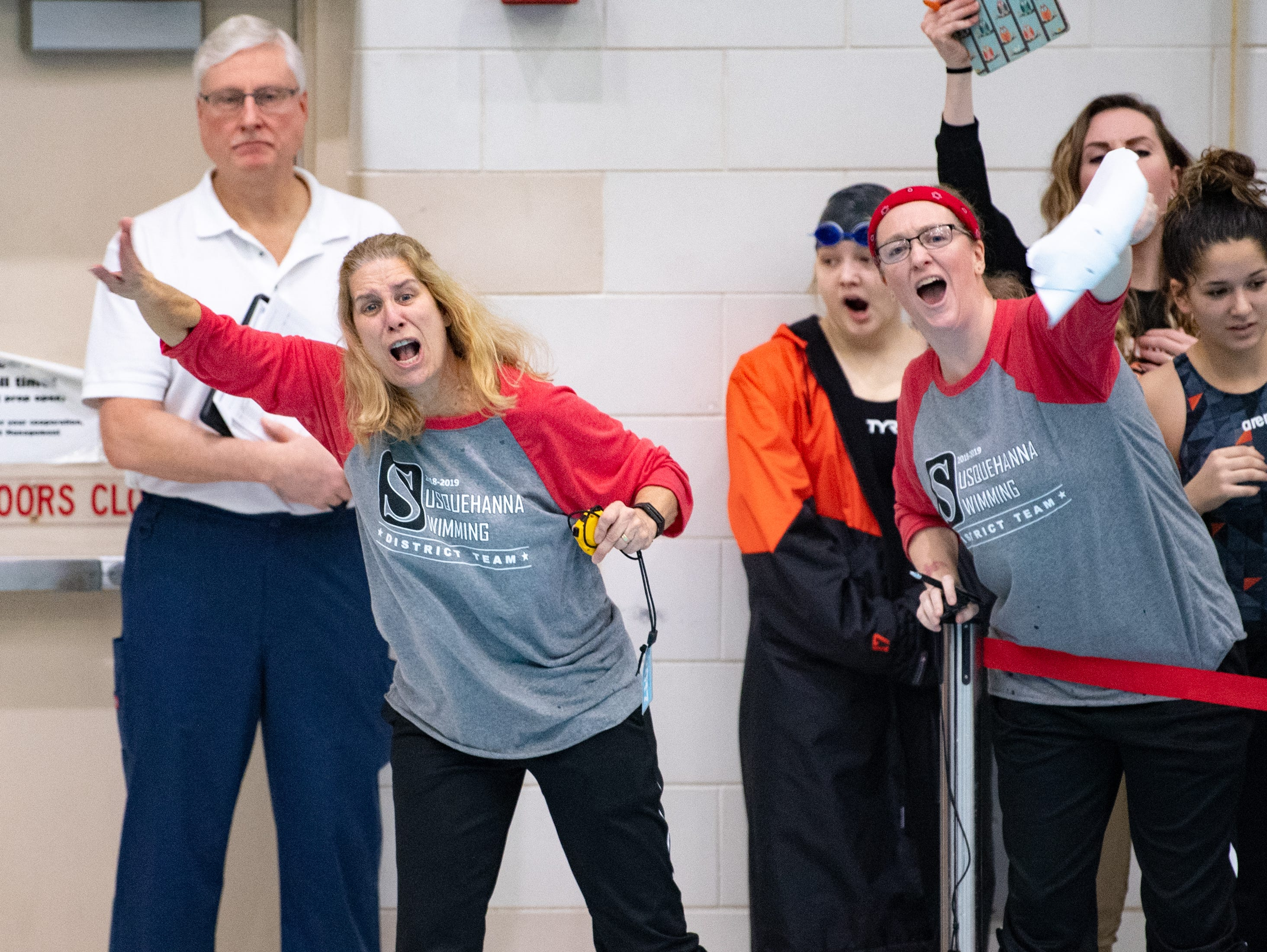 Susquehanna swimming coaches cheer their swimmers on during the PIAA District 3 Girls AA Championship, March 1, 2019 at Cumberland Valley High School.